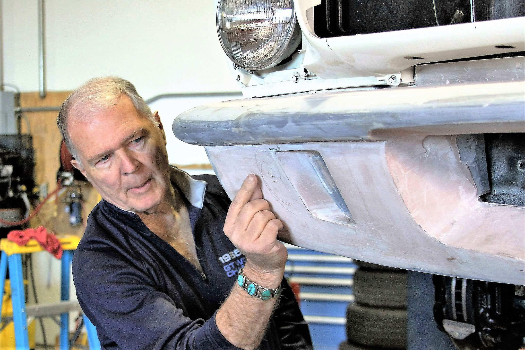 Pete Brock works on an under-construction front valance, pointing out some changes he'd like to make.
