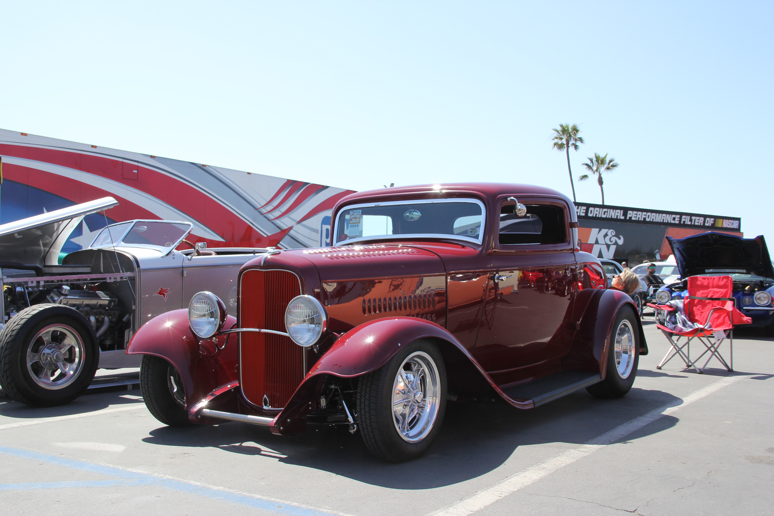 red 1932 Ford Deuce coupe at a show