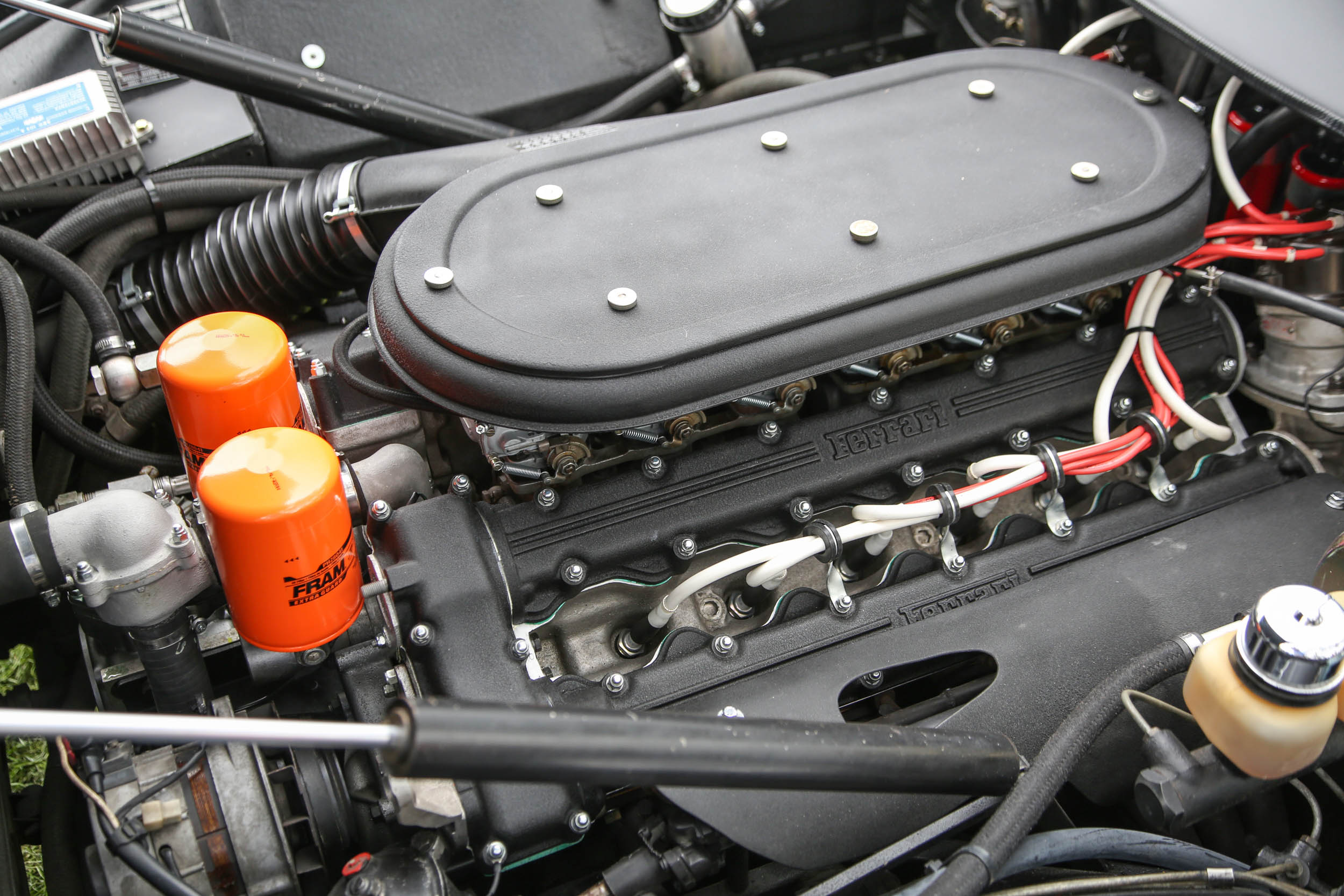 Six Webers in a row feed the front-mounted 4.4-liter Ferrari V-12 in this 365 that produces 352 horsepower.