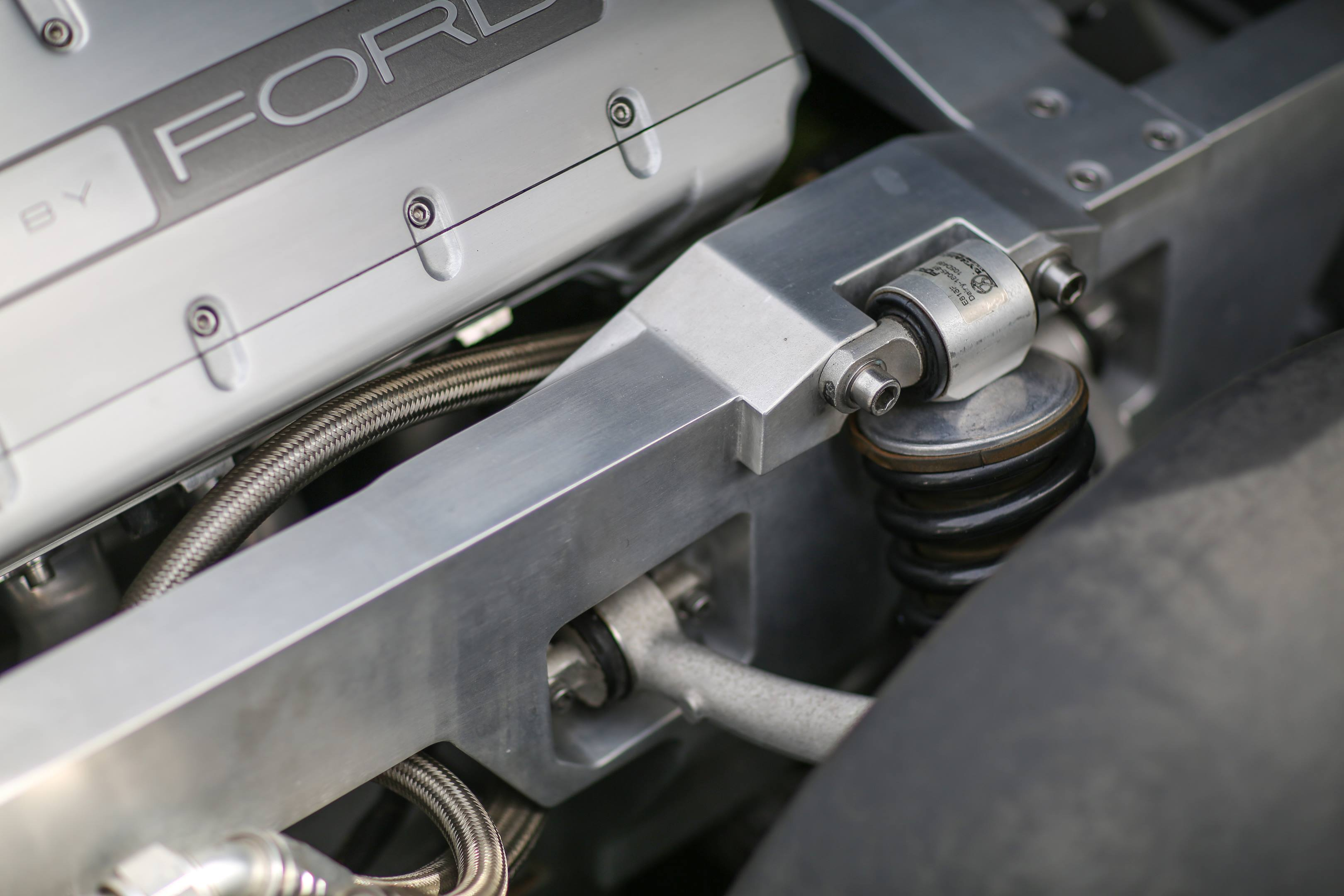 The car uses billet aluminum extensively, including these frame rail, the A-pillars, and the roll hoops behind the seats.