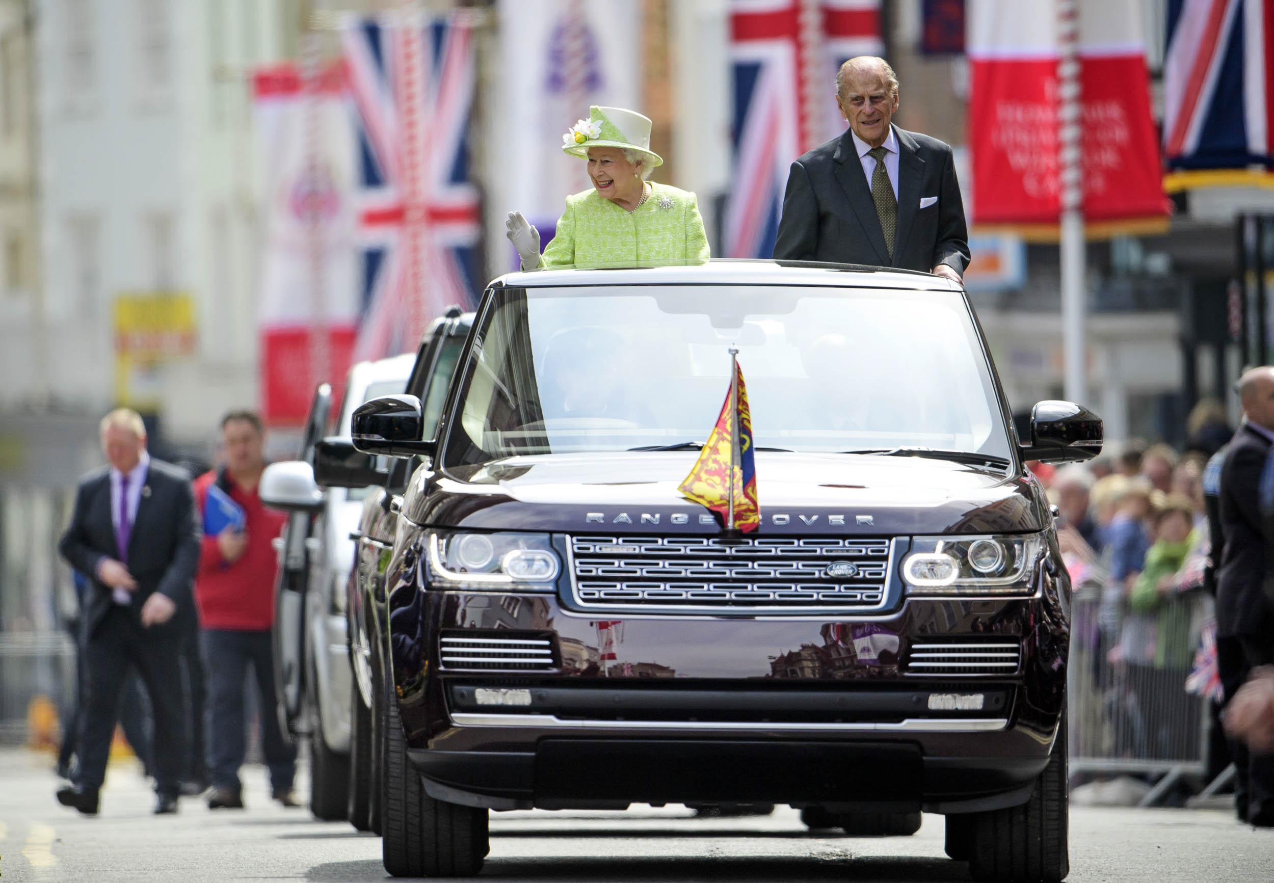 Queen Elizabeth rides in a Range Rover