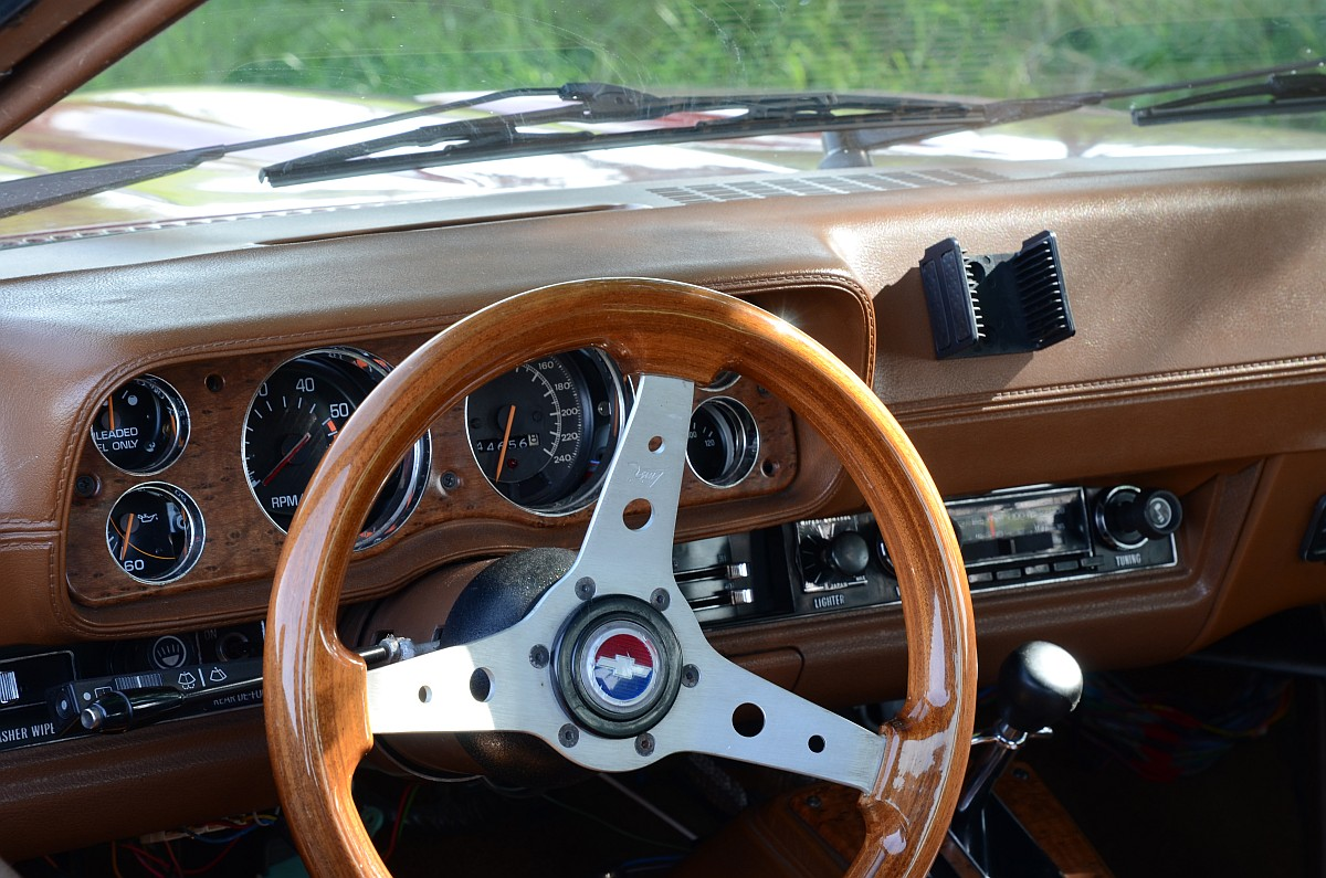 "Original Monza dash also shows European look; wheel is aftermarket. Is that ""Fox on the Run"" playing on the radio?"