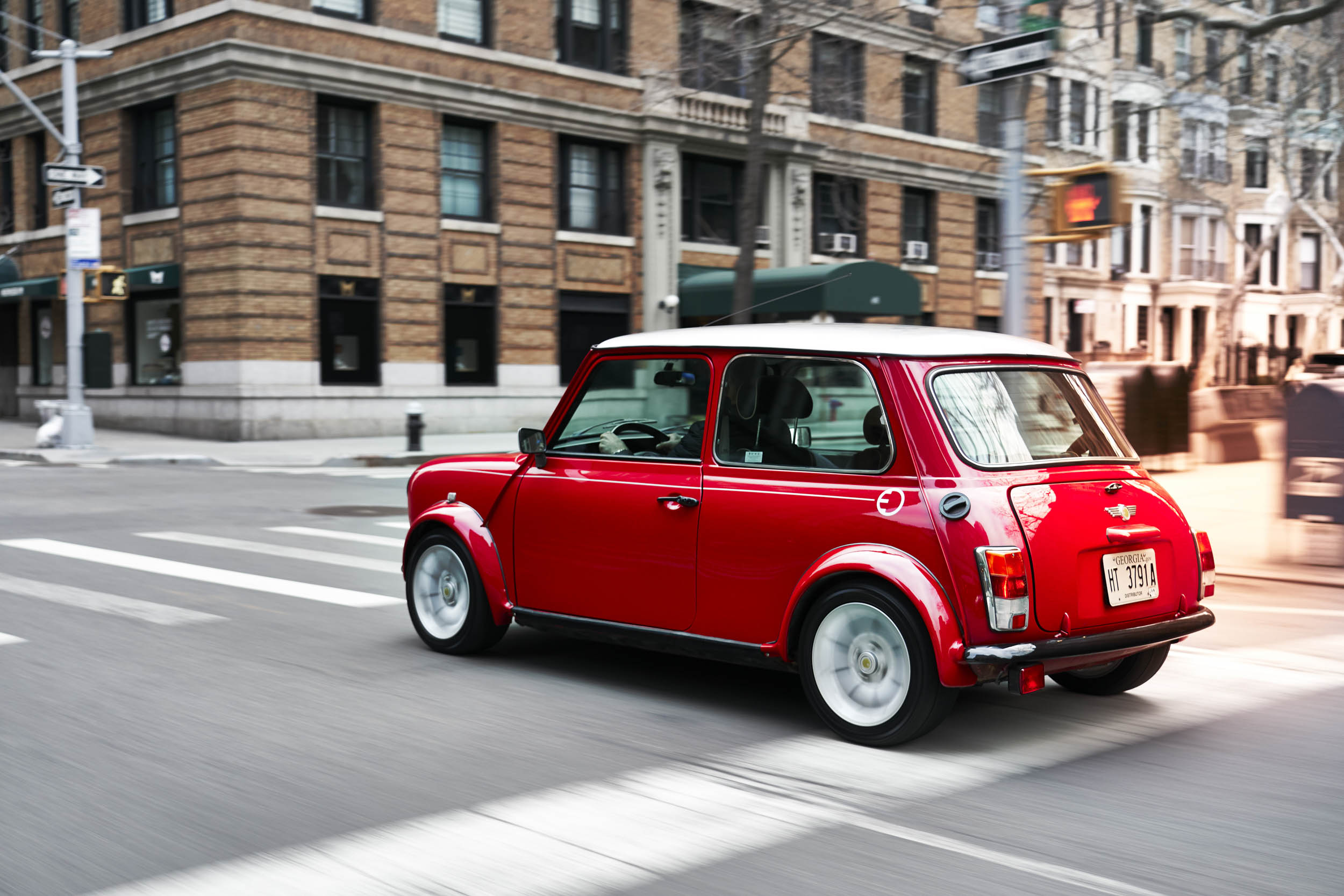 electric classic Mini driving the streets of New York