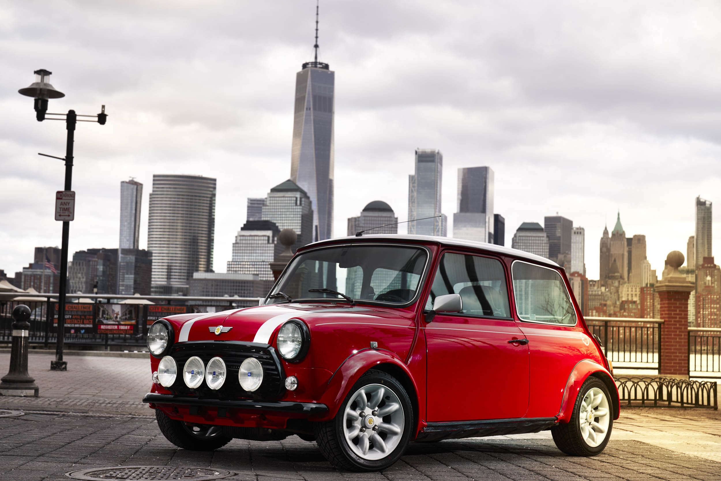 electric Mini in front of the New York skyline