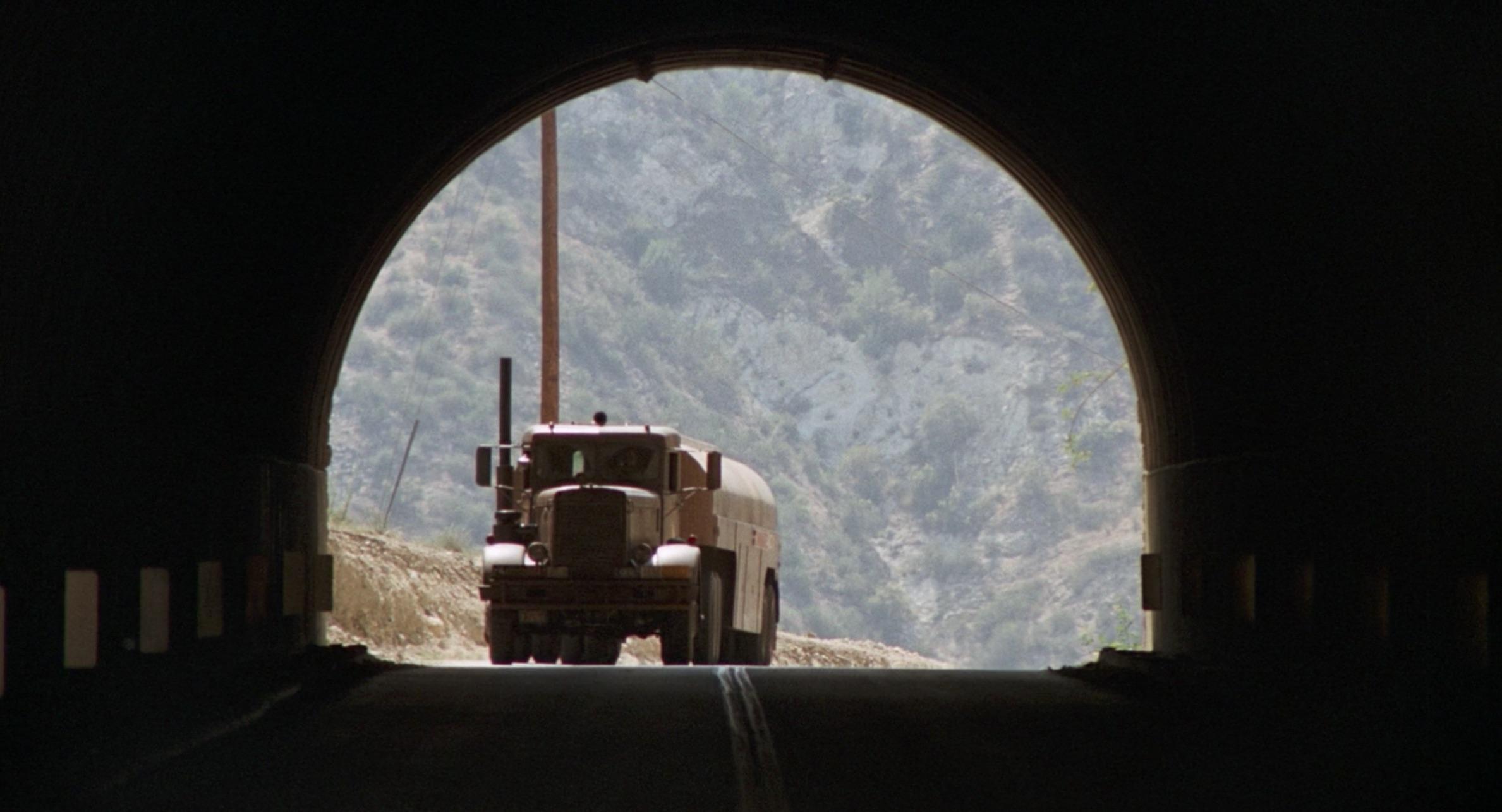 1955 Peterbilt 281 tanker driving through a tunnel