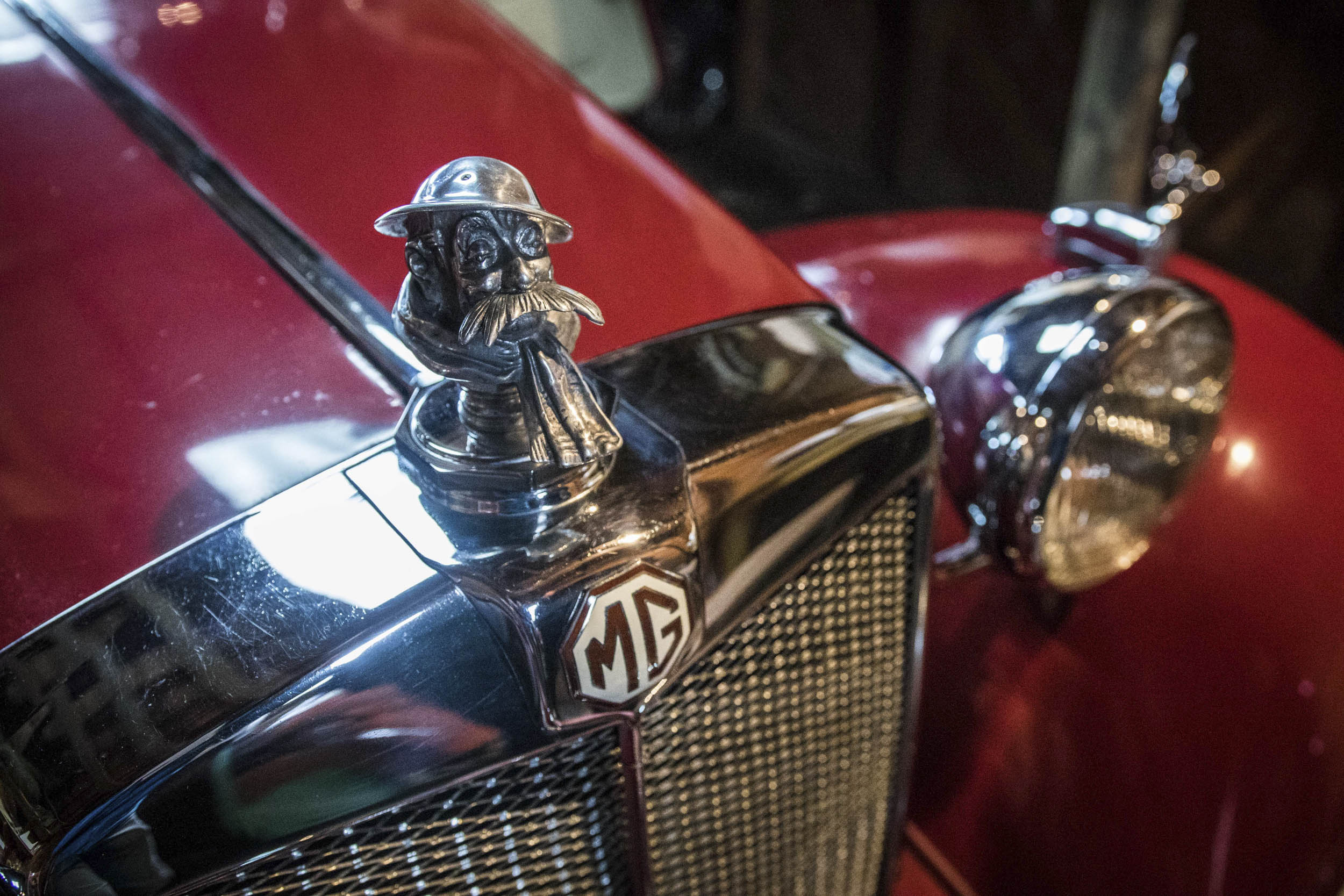 "The hood ornament atop the radiator of Newby's modified 1954 MG TD is the spitting image of Old Bill, the grizzled old ""Tommy"" war veteran sketched by WWI British Army cartoonist Bruce Bairnsfather."