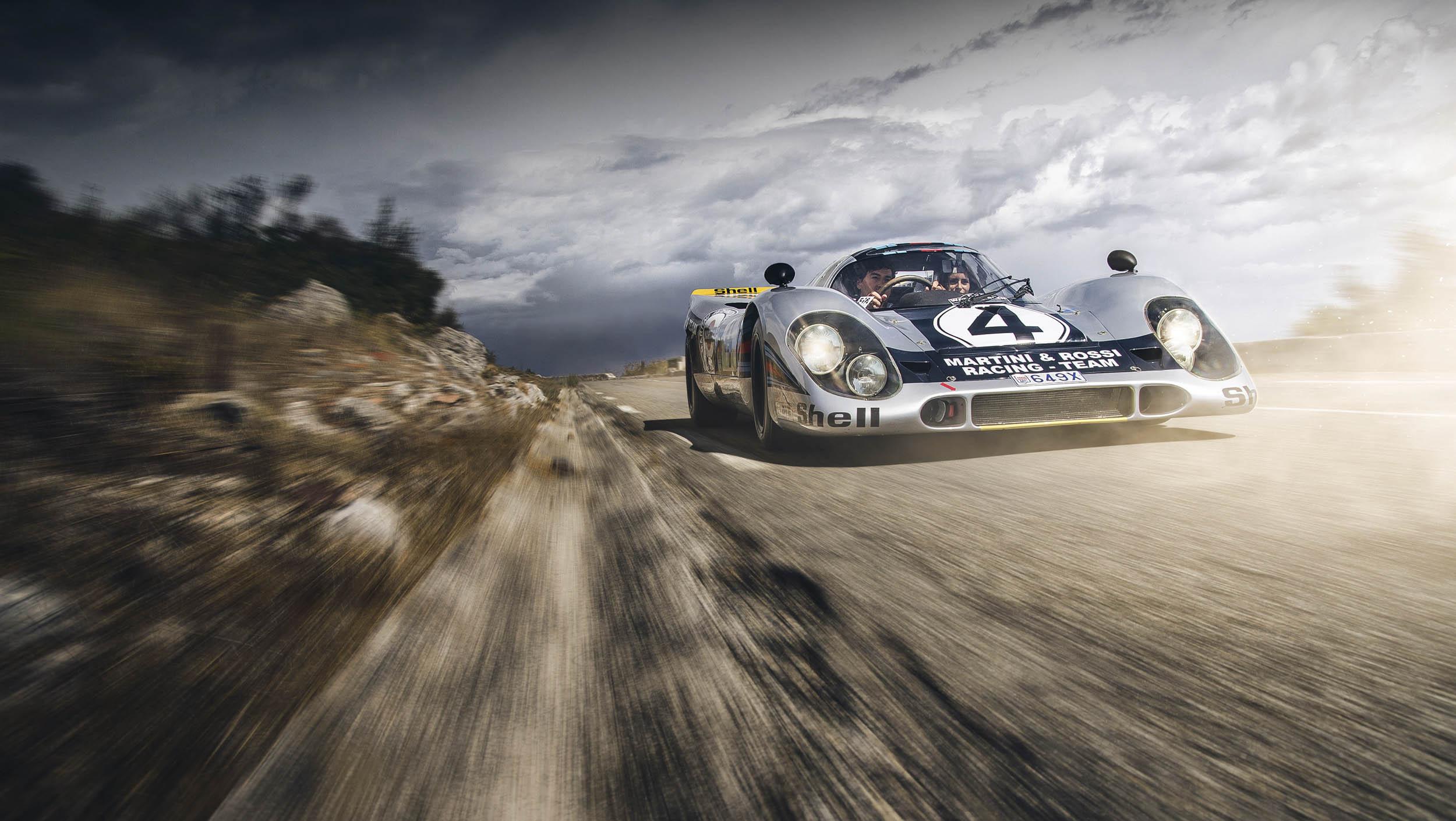 Porsche 917K driving on the highway