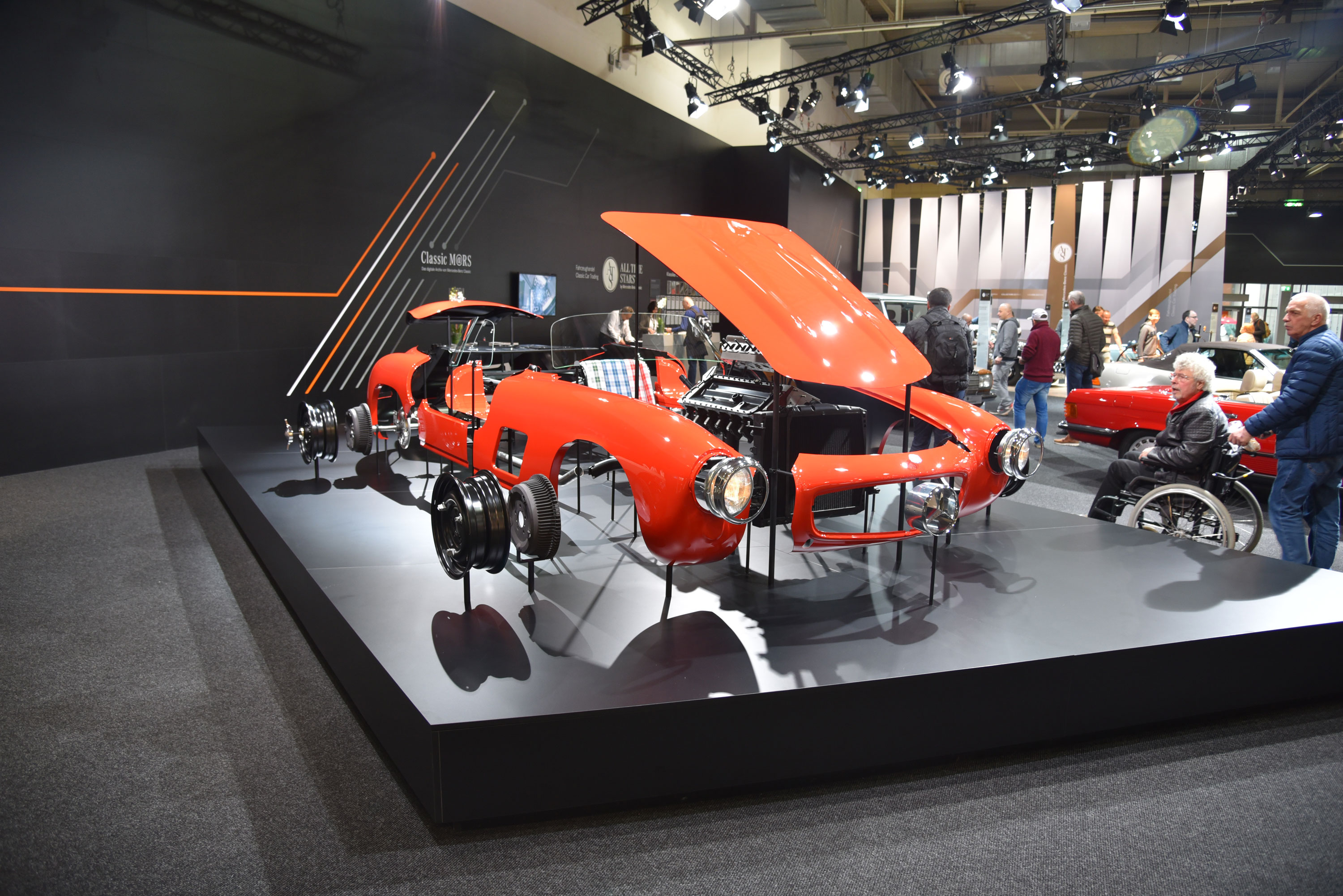 Factory parts and restoration programs were lavishly promoted on corporate stands, such as this one from Mercedes-Benz, whose display rivaled that of any new-car auto show for size and number of vehicles.