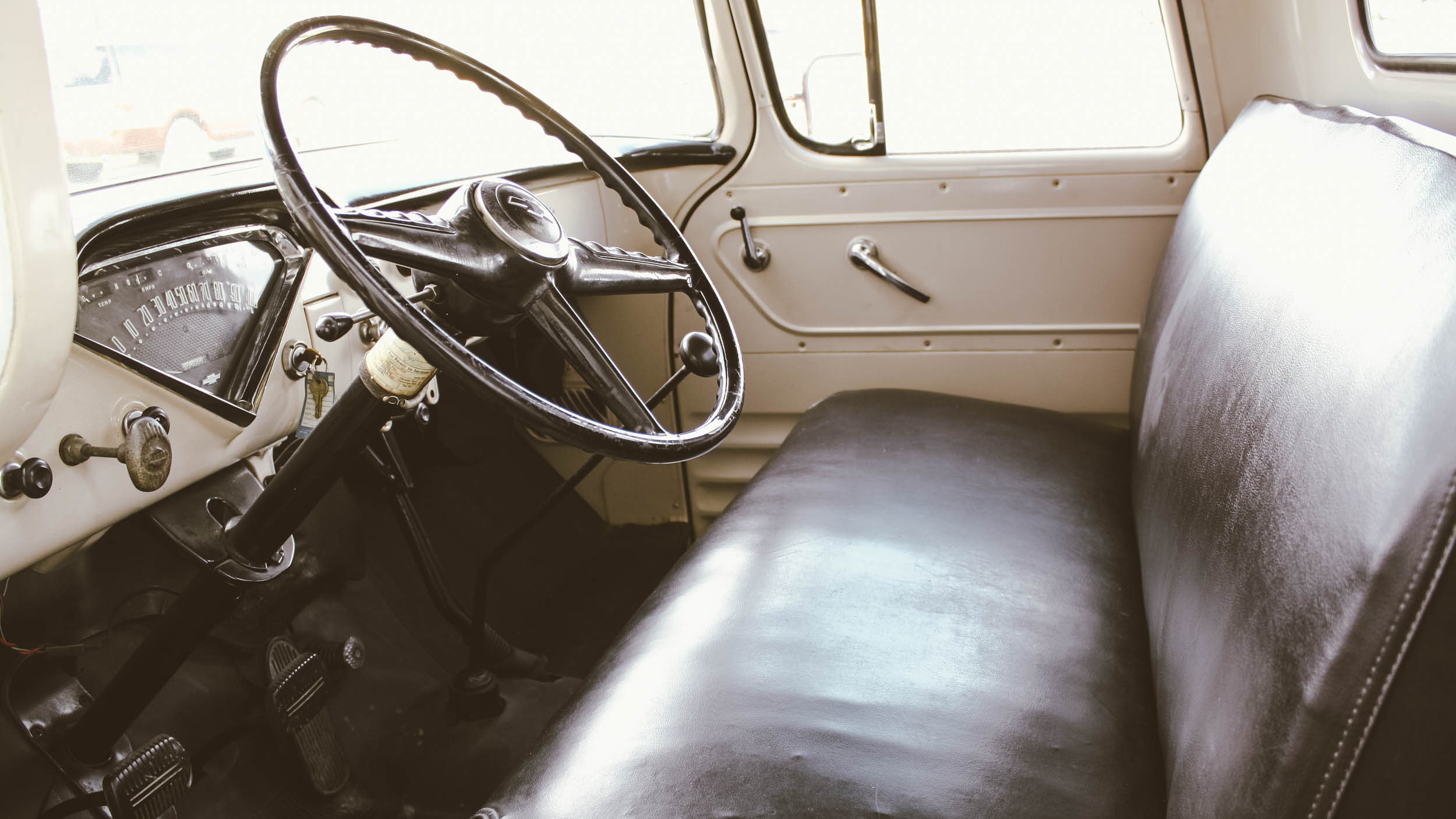 The interior is simple, with rubber floor mats directly over a steel floor. The bench seat provided most of the comfort for the driver when driving the truck without a load. The '55, as many leaf-sprung trucks, rides far better with a load than without.
