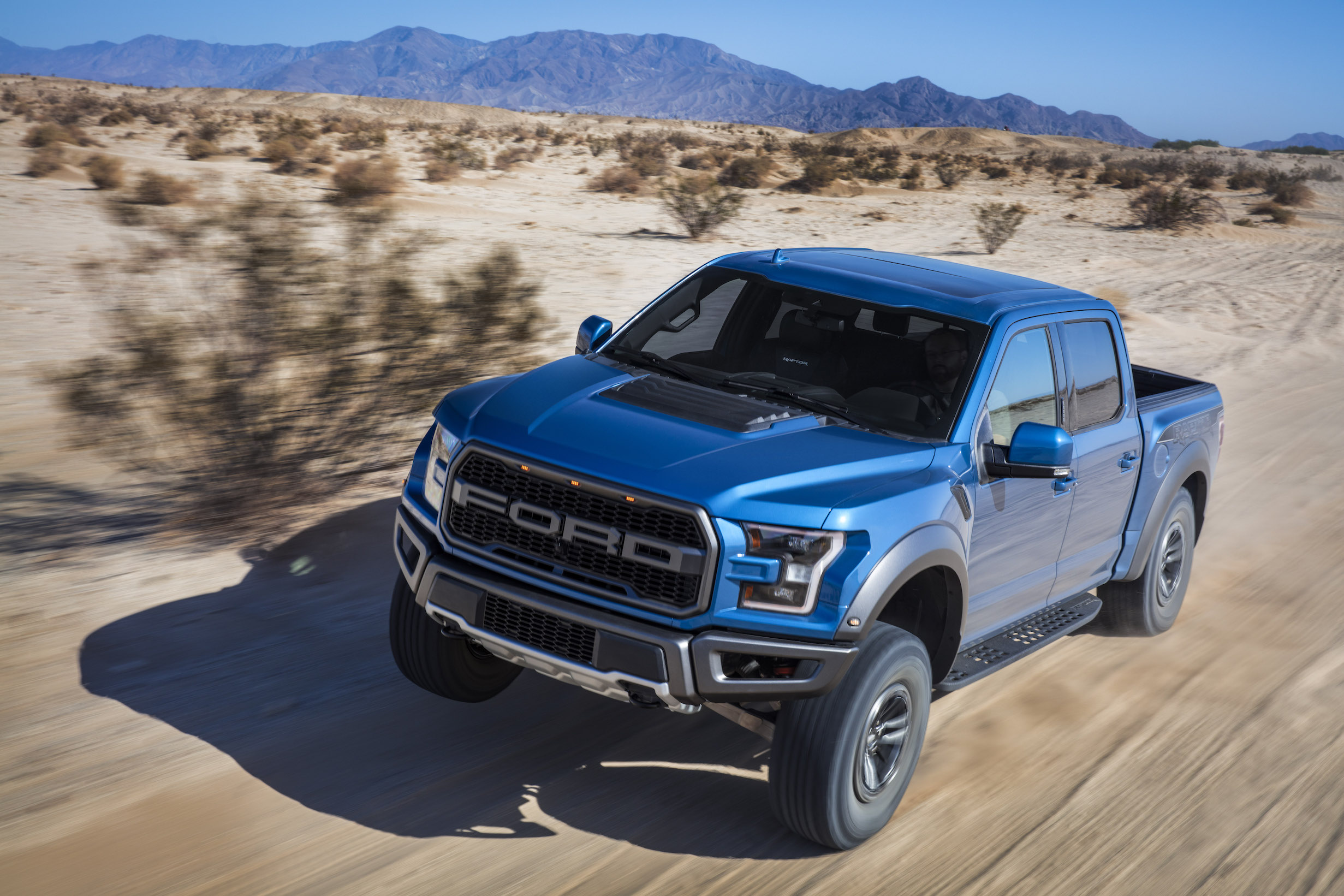2019 Ford F-150 Raptor on dirt trail off road