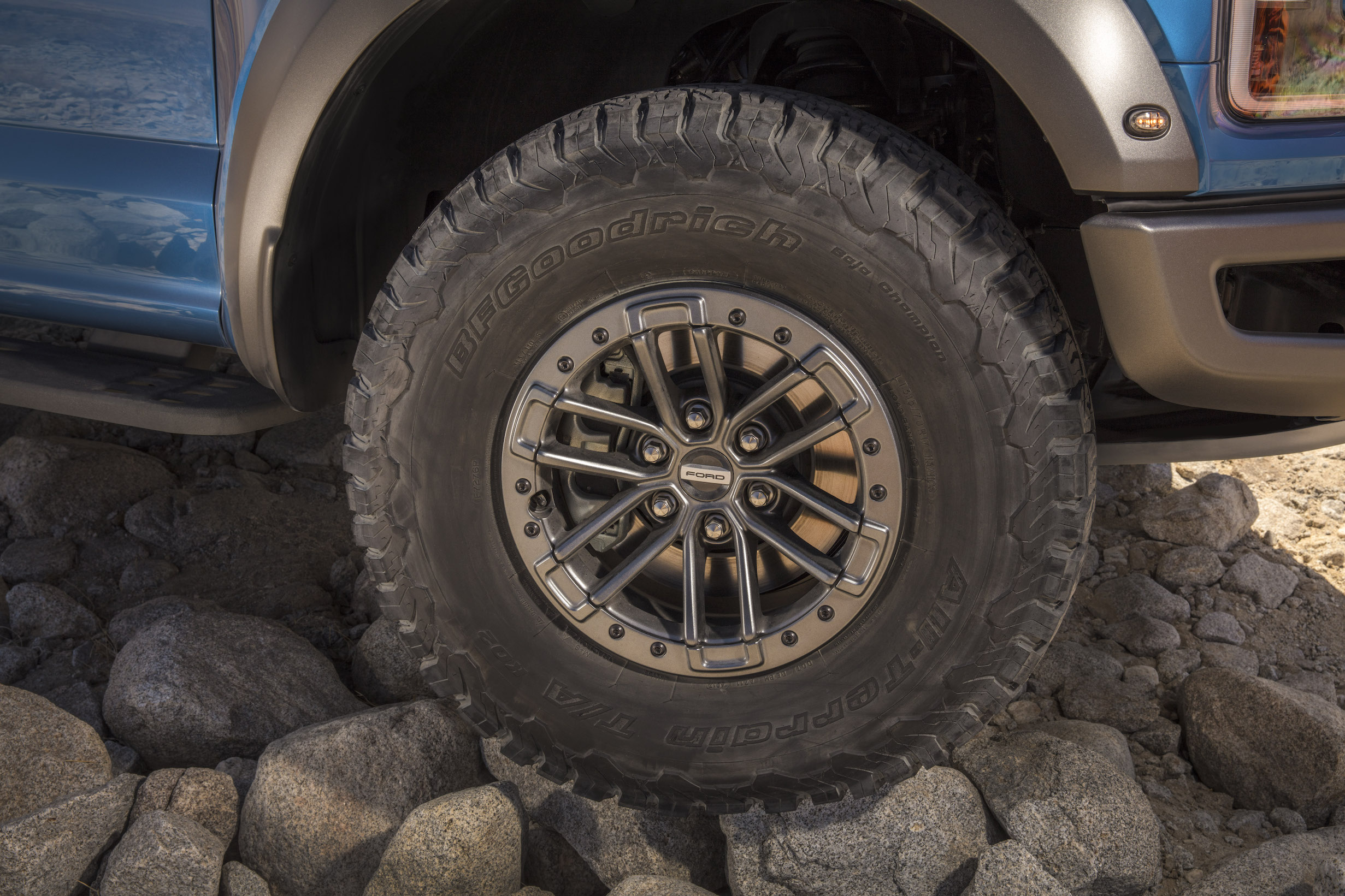 2019 Ford F-150 Raptor tires on rocks