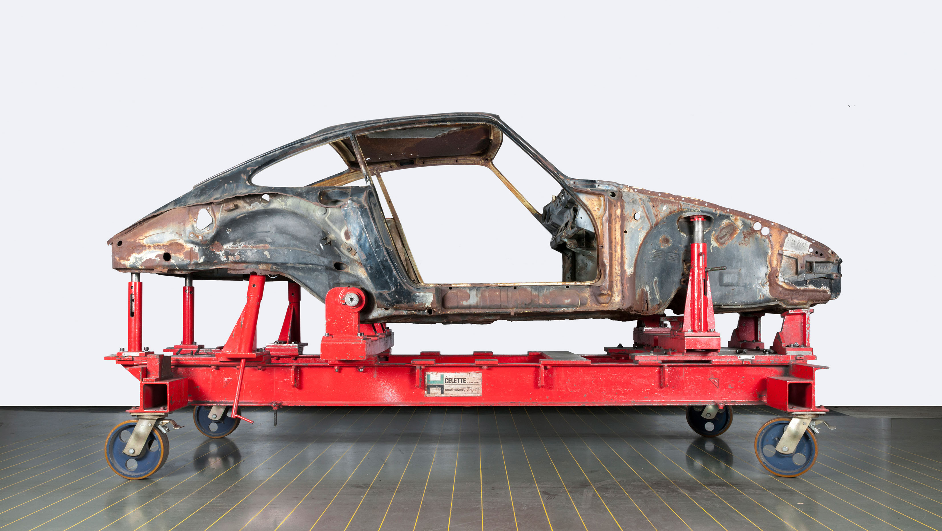 Restoration underway. 1972 Porsche 911 2.5 ST body on hydraulic