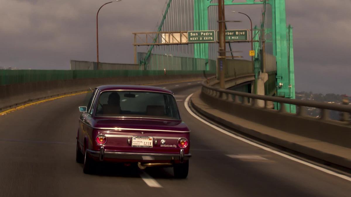 BMW rear crossing the bridge