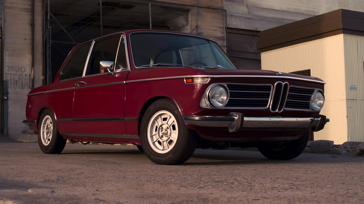red BMW 2002 front 3/4