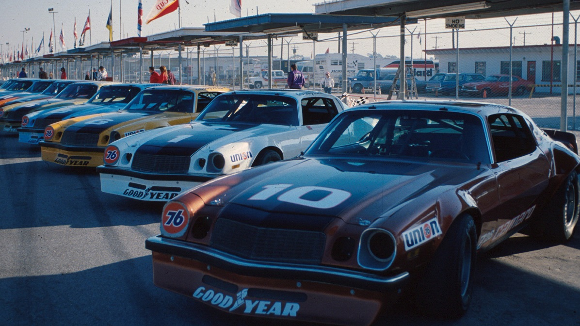 "The original IROC Camaro race cars were based on the 1974 production model. Despite ""Z28"" door decals, the Z28 had been temporarily dropped by the time IROC first began racing Camaros."