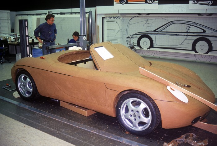 """Behind the Boxster concept clay model, the """"996"""" rendering for the 911 is seen. Both Boxster (986) and the new 911 (996) would share many parts."""