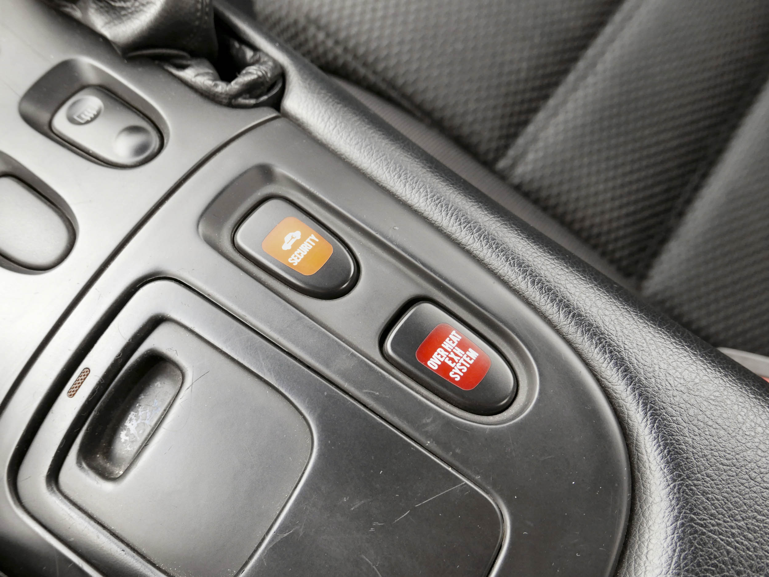 Mazda RX-7 security and overheat buttons