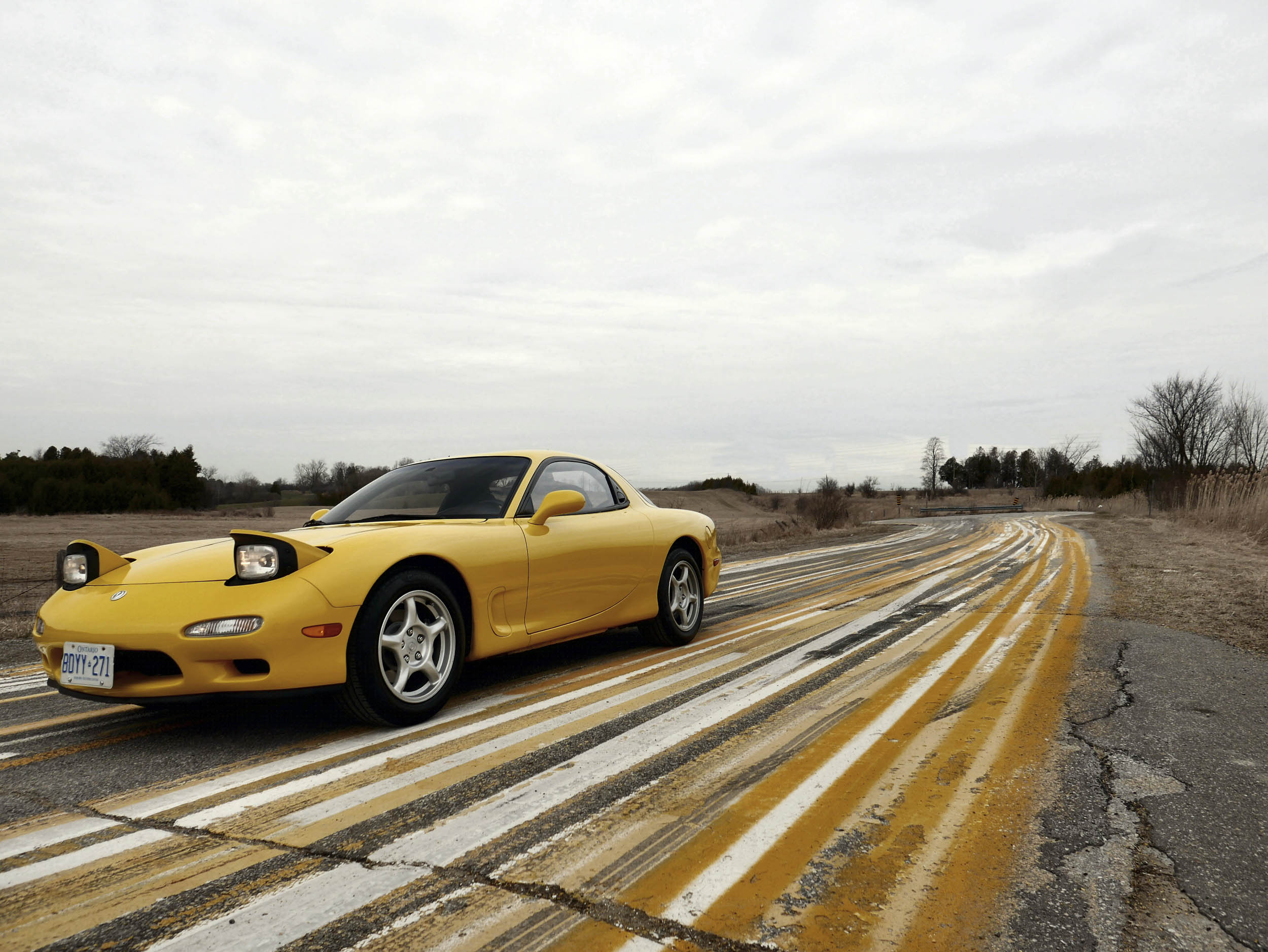 yellow 1993 Mazda RX-7