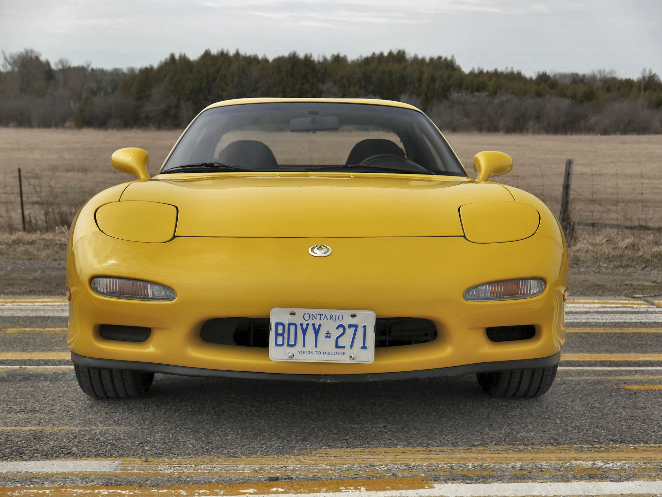 Yellow 1993 Mazda RX-7 front
