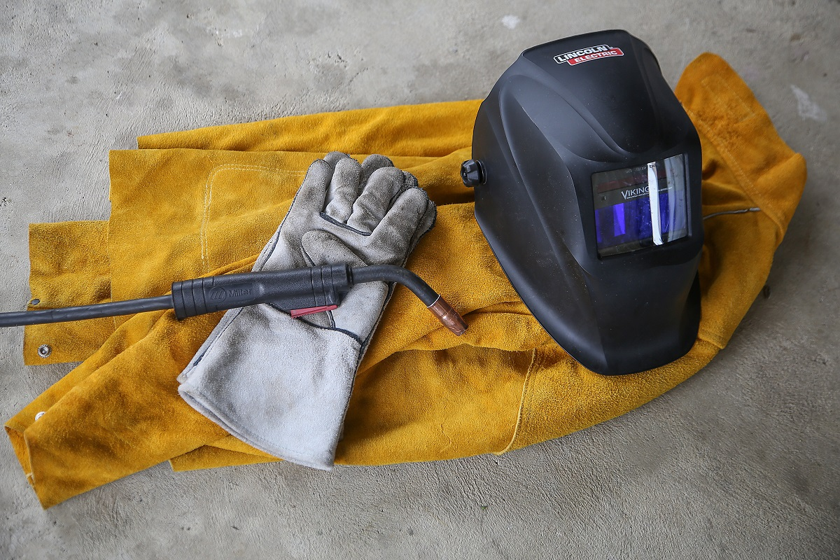 Welding helmet, gloves, and non-flammable clothing