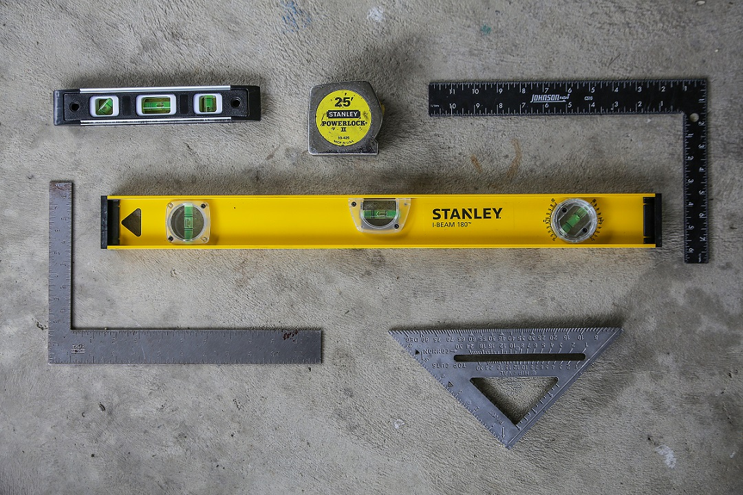 Levels, squares, and tape measure