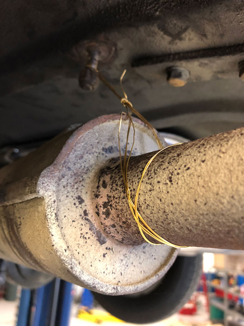speaker wire holding up the muffler