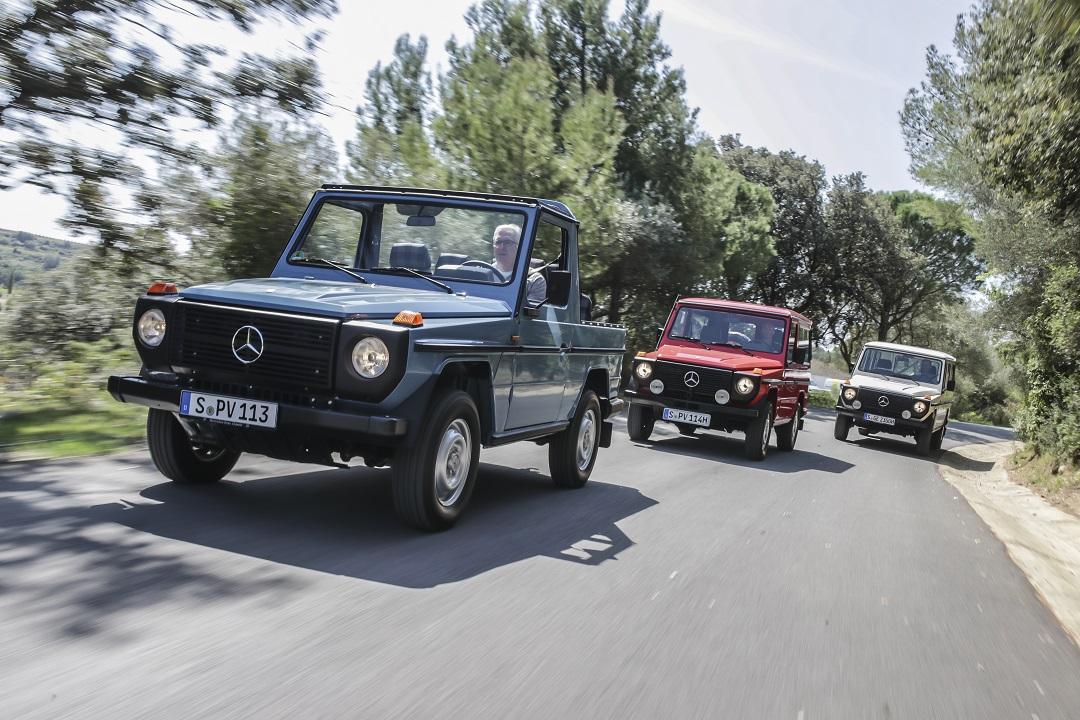 Mercedes-Benz G-wagen red white blue on pavement
