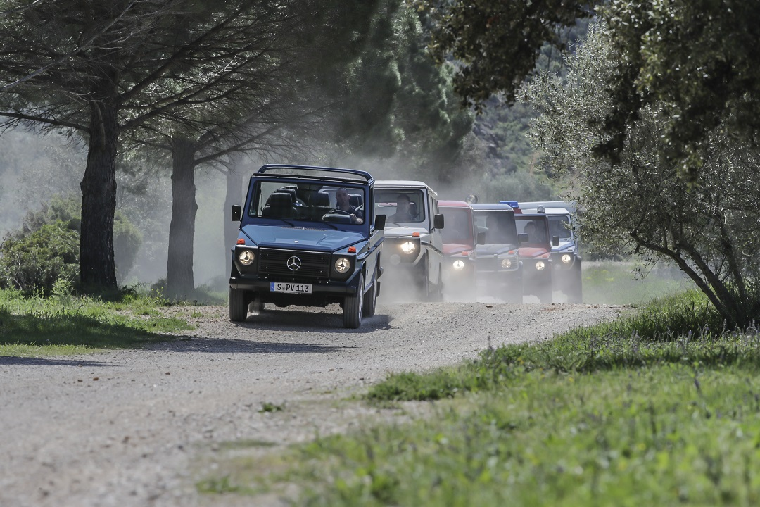 Mercedes-Benz G-wagen group dirt road in line