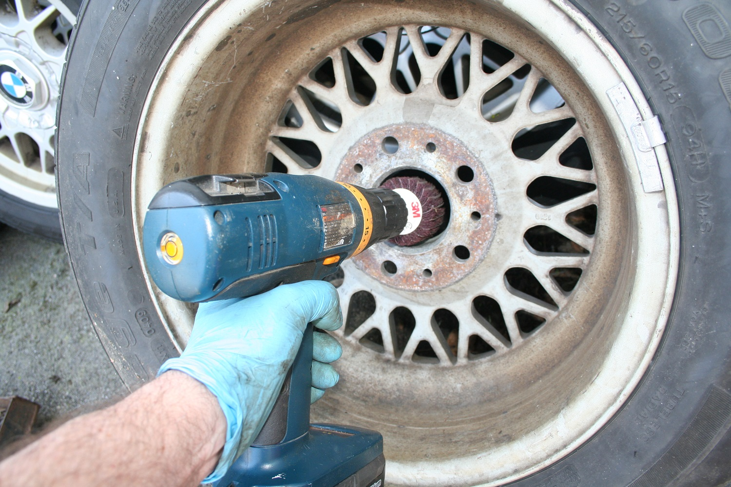 Cleaning corrosion off the wheel center bore. Drill with cleaning wheel