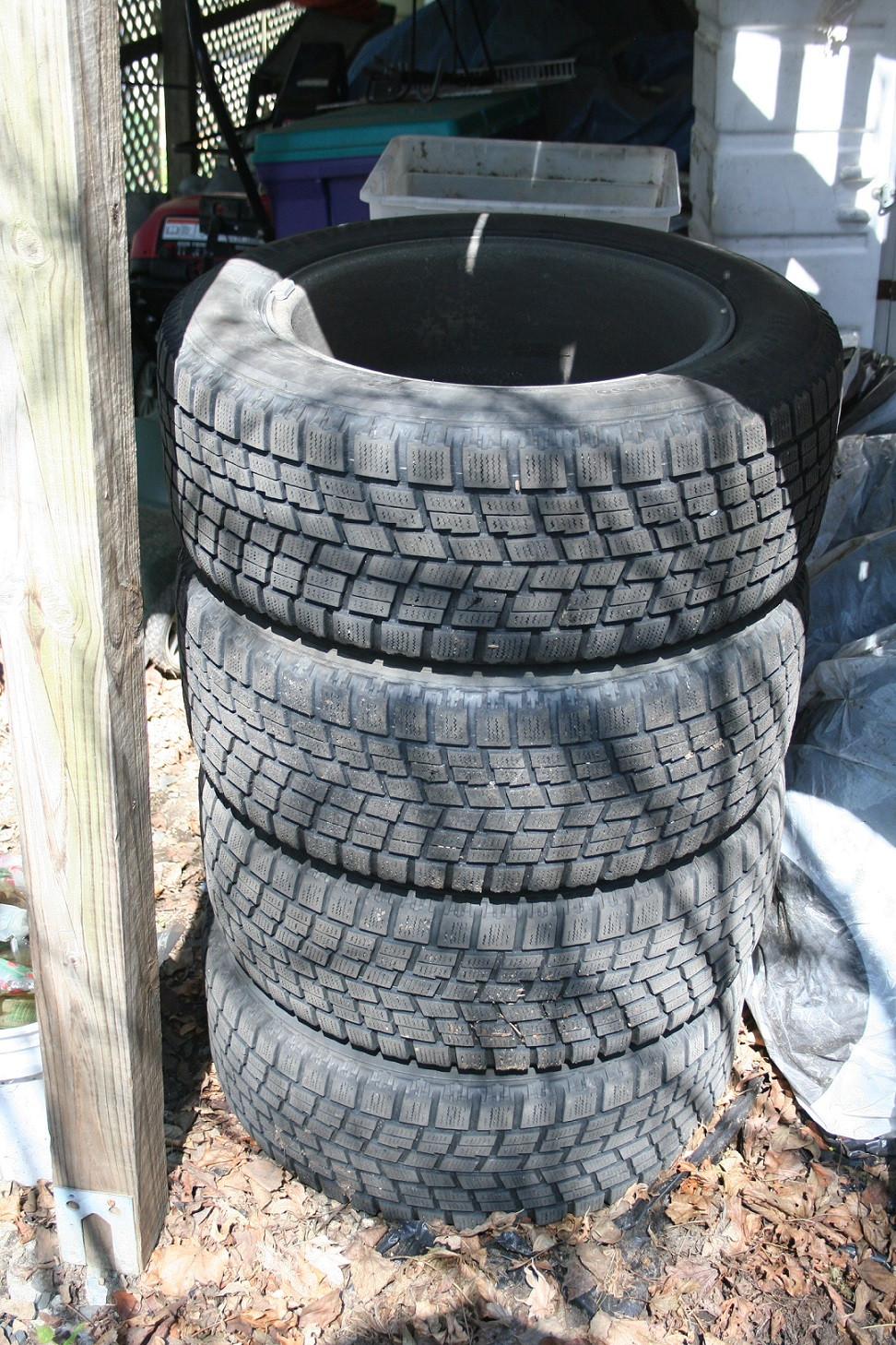 Stacking wheels and tires is tempting, as it reduces space, but it's the worst way to store them outside. (This is just for show. I don't really do this. Honest!)