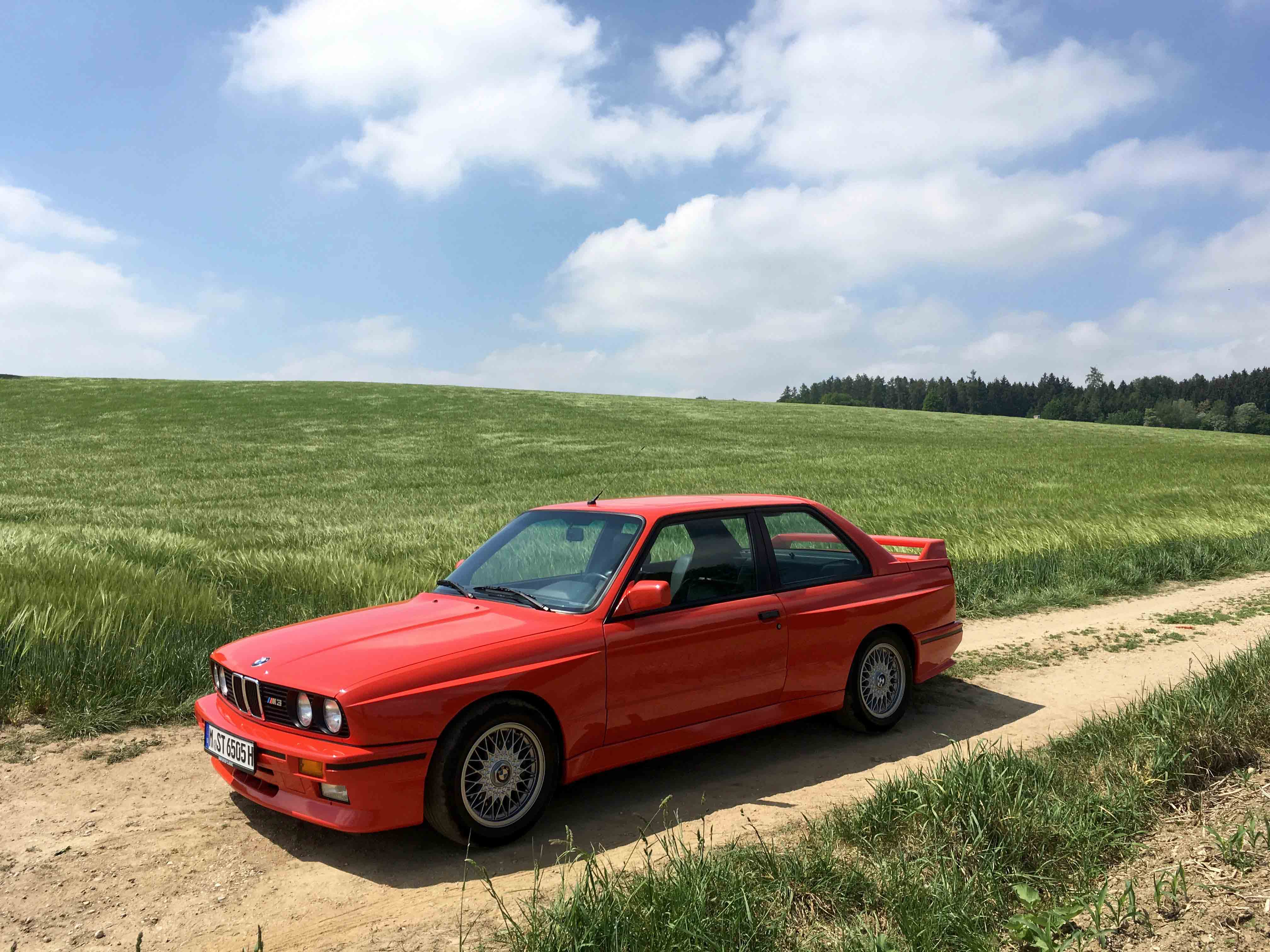 1987 BMW M3 Green field background dirt road