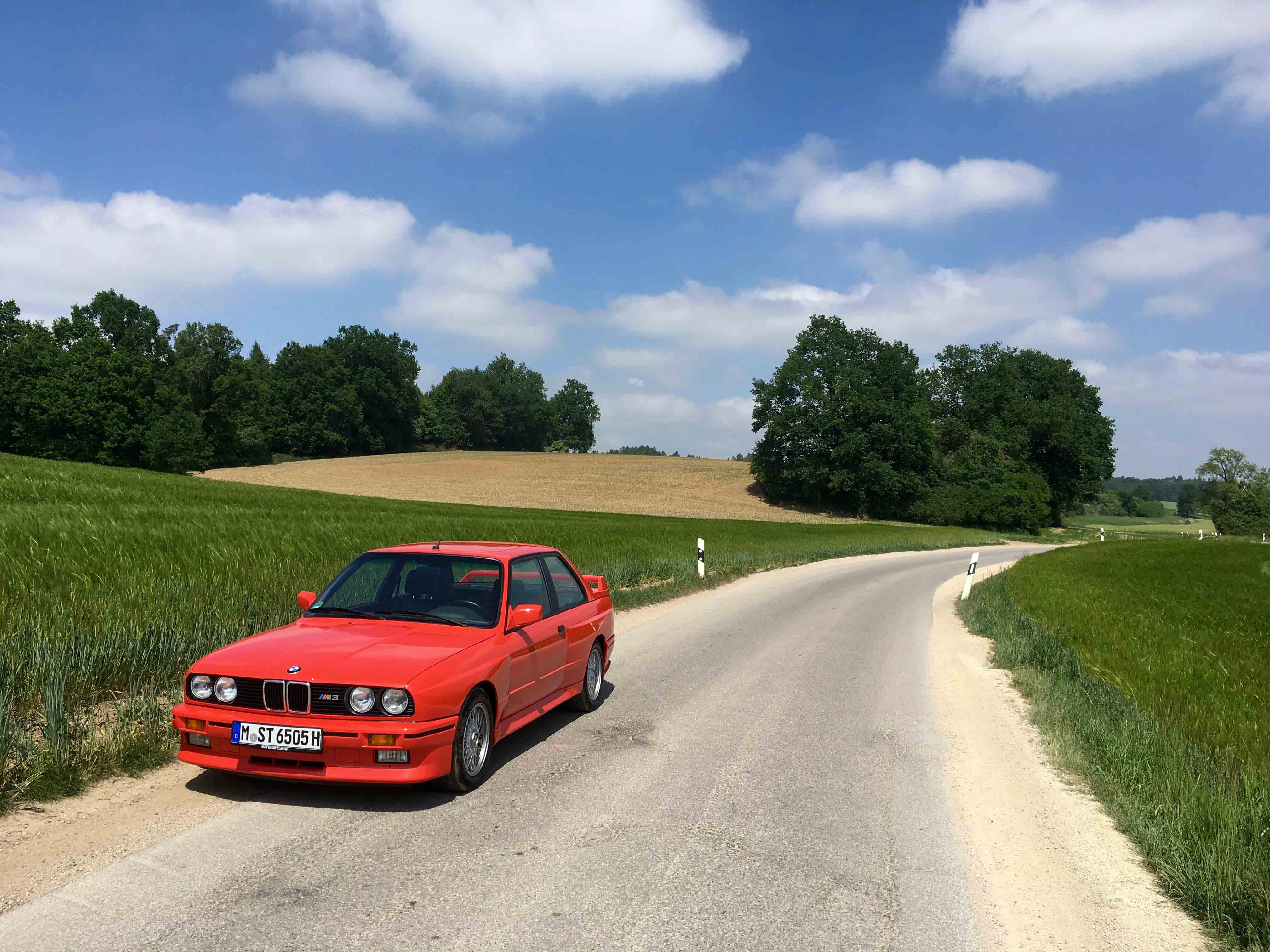 1987 BMW M3 two lane road