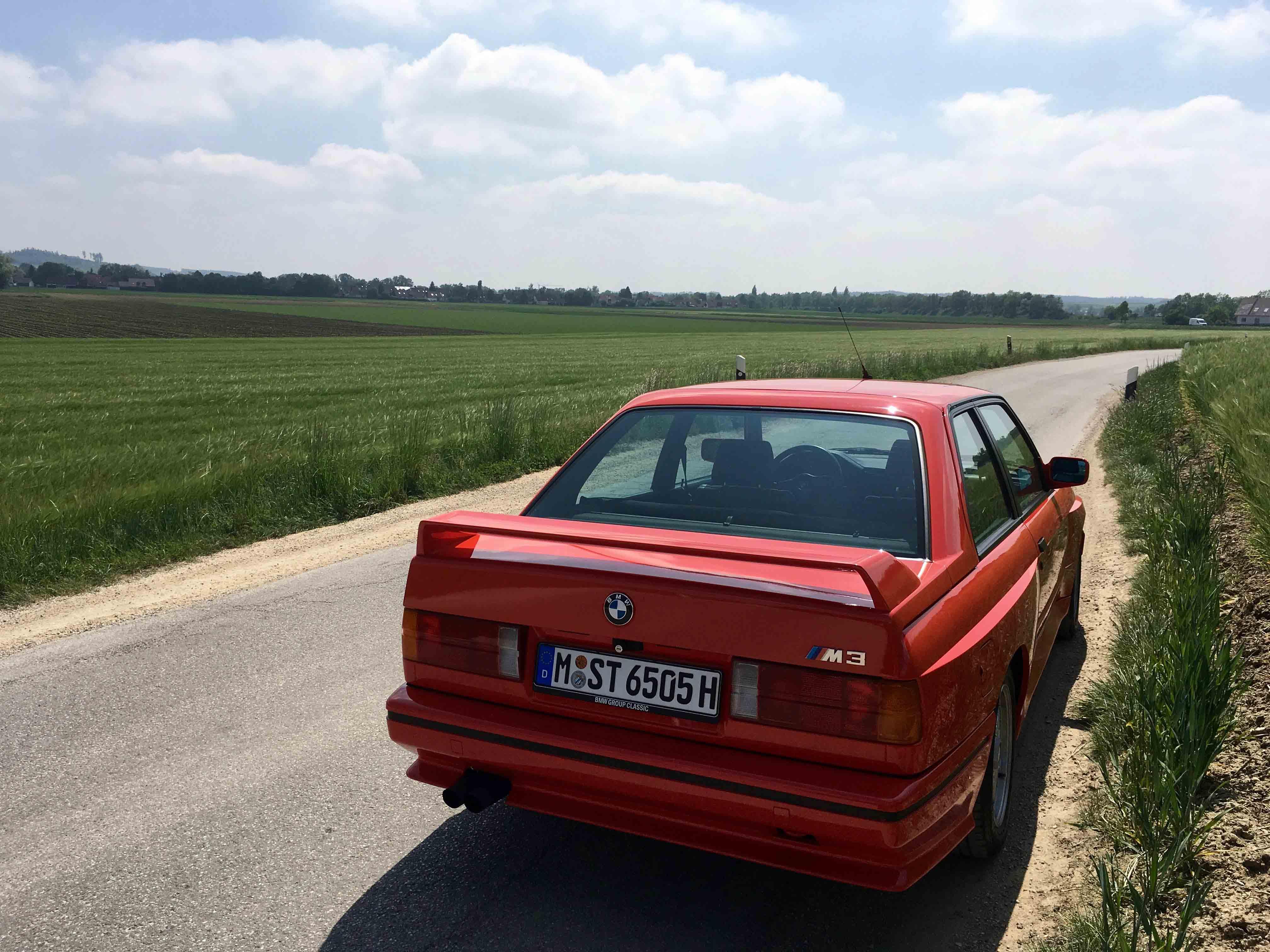 1987 BMW M3 two lane road rear