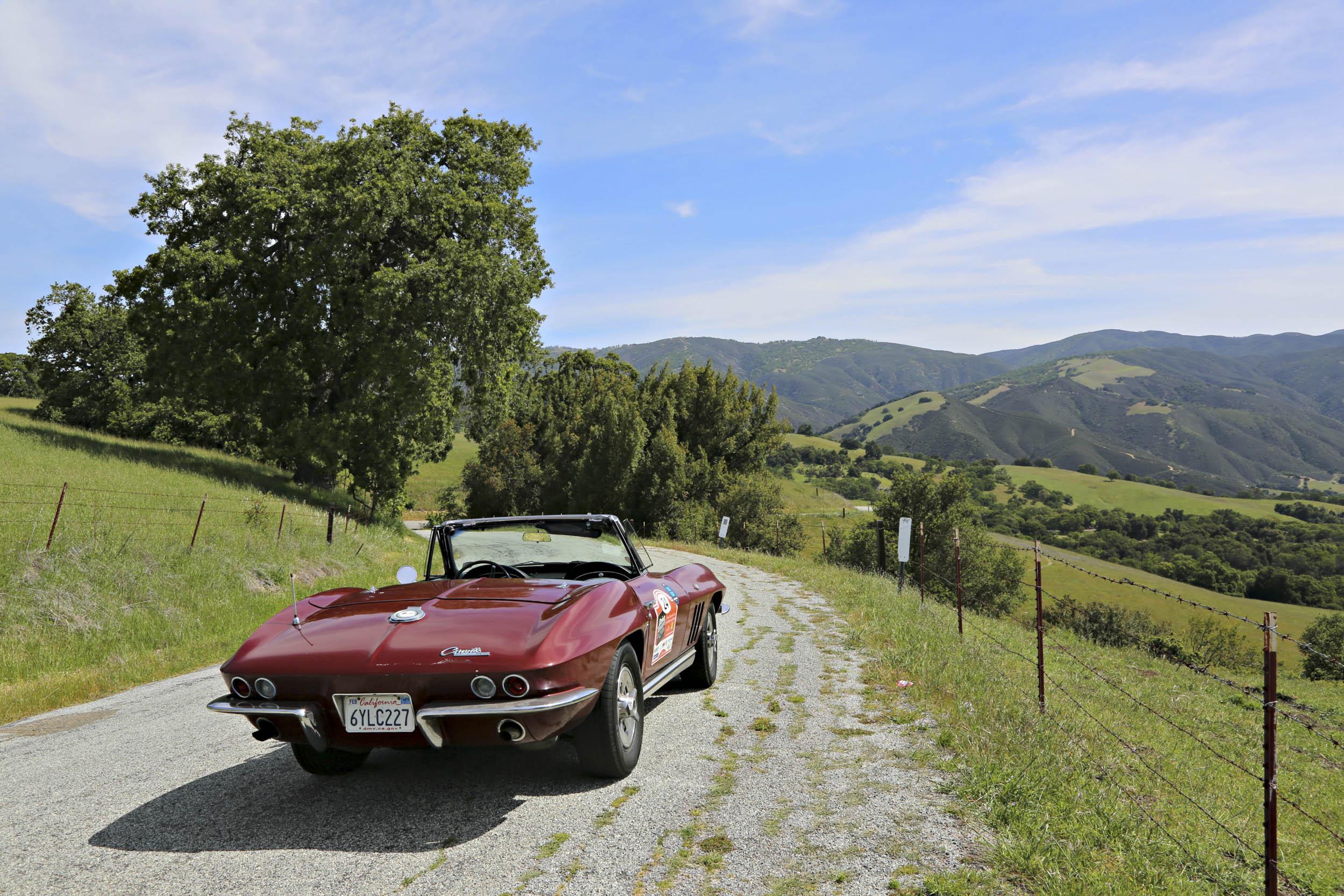1965 Chevrolet Corvette convertible driving back trails
