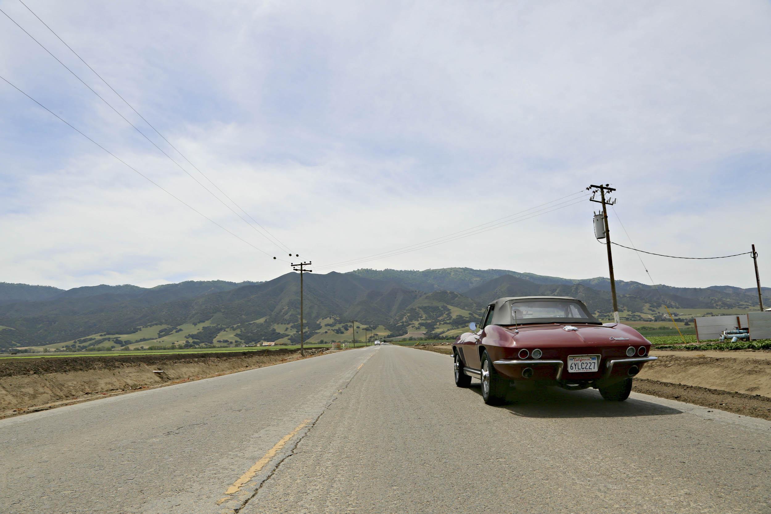 Corvette driving towards the mountains
