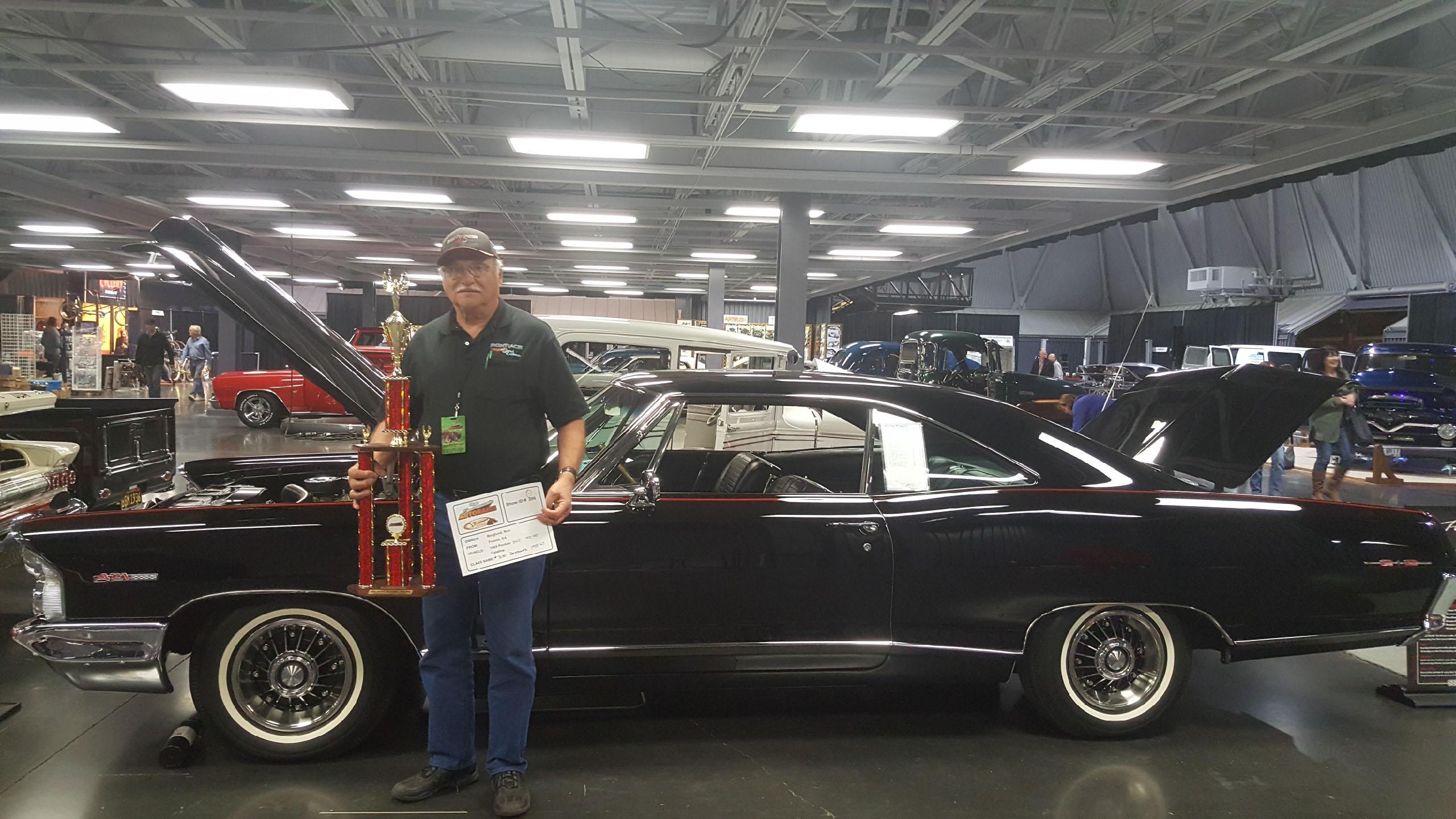 Ron Berglund and his 1965 Starlight Black Pontiac 2+2