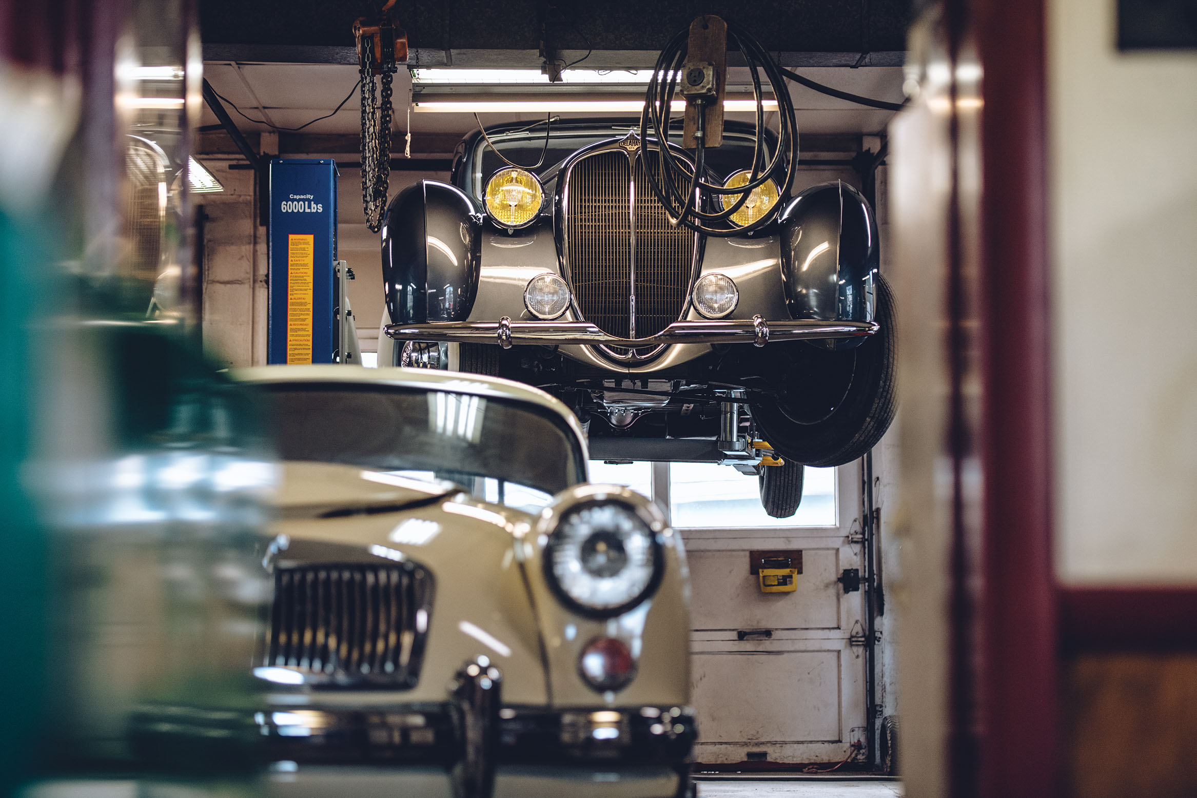 The changeover from Carriage Craft to Proper Noise has resulted in a broader spectrum of clientele. You'll still find MGs, like this white A coupe, but also Volvo PV544s and the occasional Delahaye.