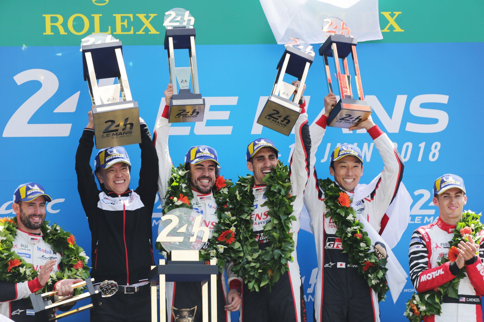 Toyota Gazoo Racing hoist trophy after victory