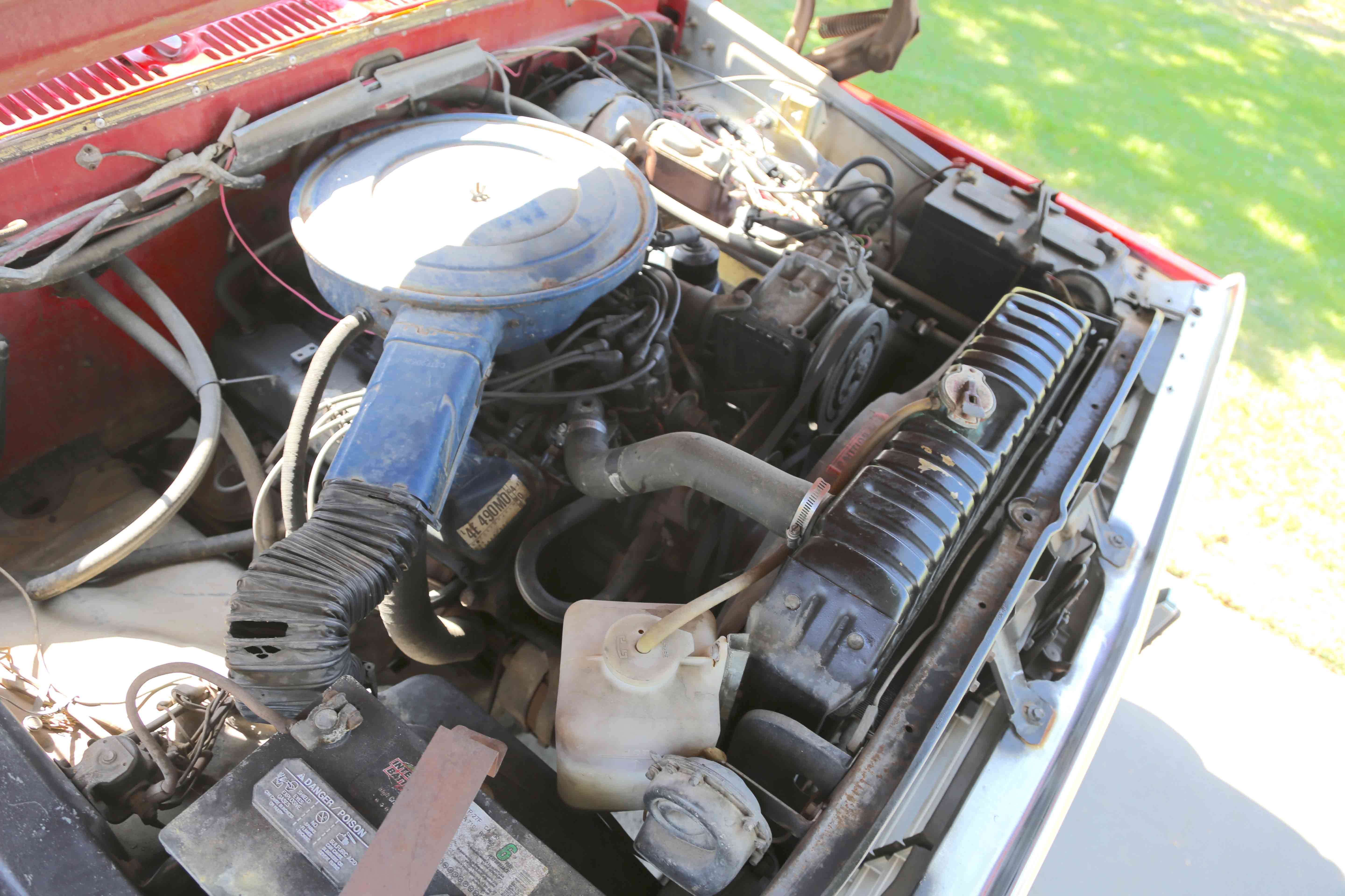 The optional 460-cubic-inch engine was the largest in the industry. Dual batteries were standard with the Super Camper Specials—one for the truck and one for the camper. It's dirty because it's used.