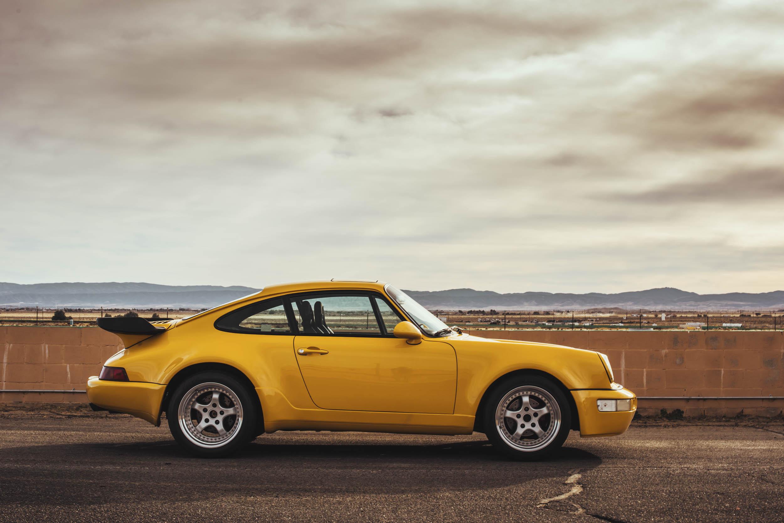 Yellow 1975 Porsche 911 profile