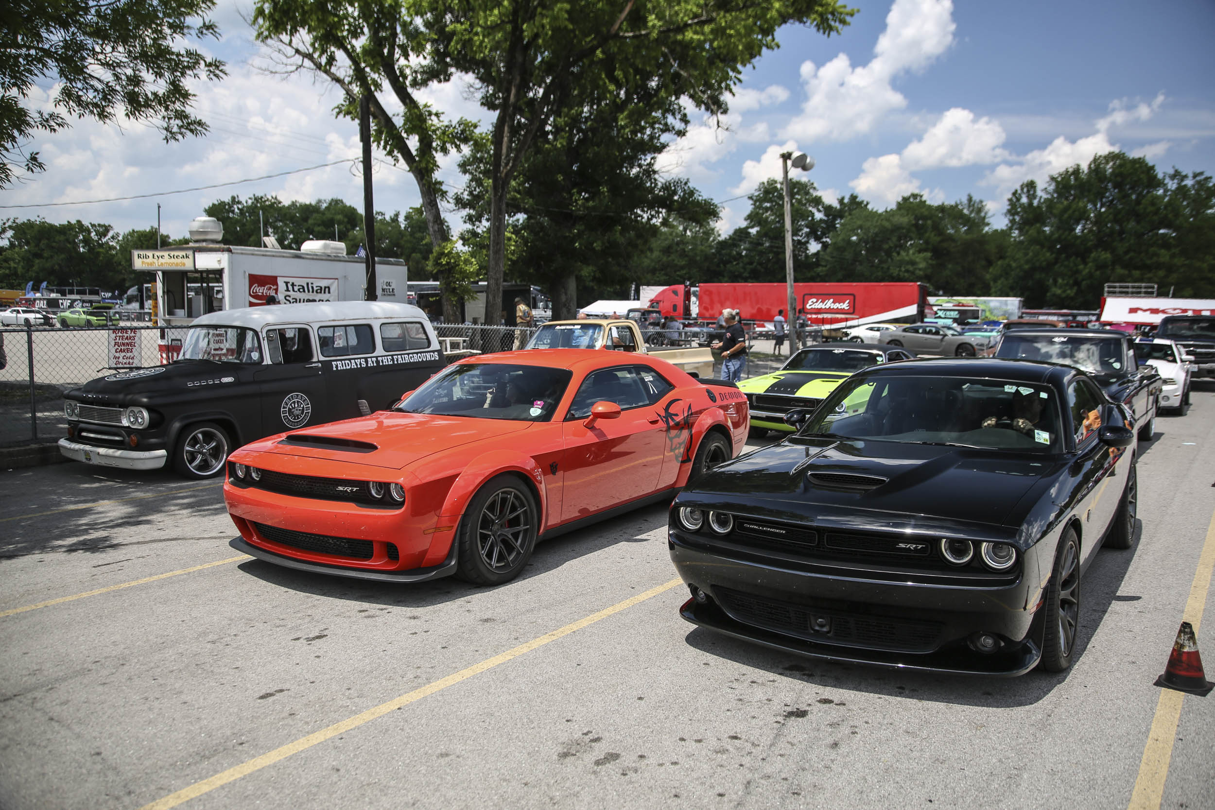The staging lanes for the dragstrip offered an eclectic mix of import and domestic, old and new. Here's a Demon and Hellcat waiting to battle. Behind the Demon is an E-body Challenger.