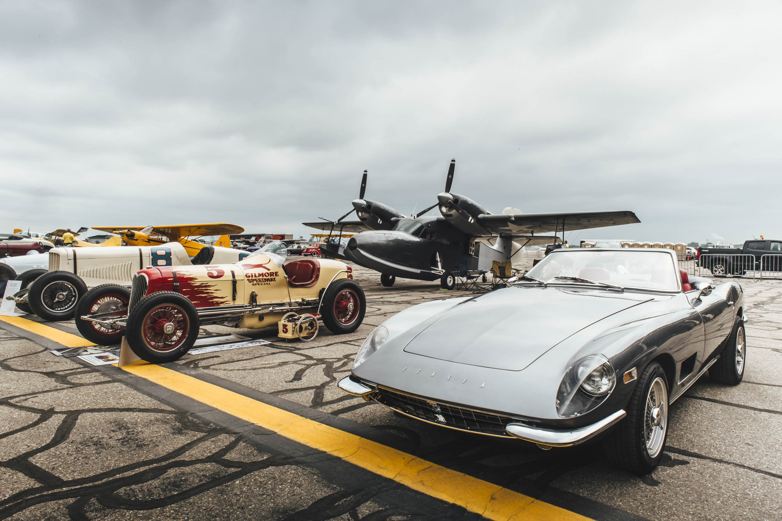 cars and planes on display at wings and wheels
