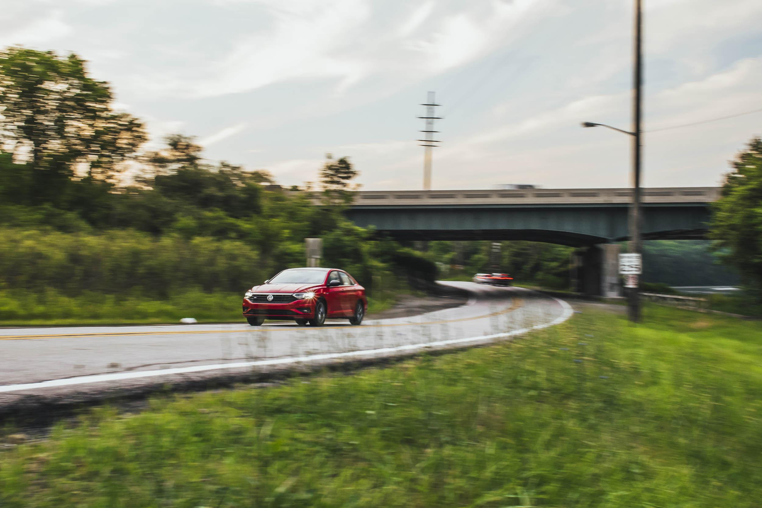 red volkswagen jetta r-line on road