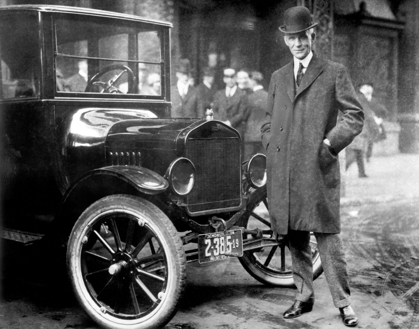 Henry Ford with a Model T in 1921
