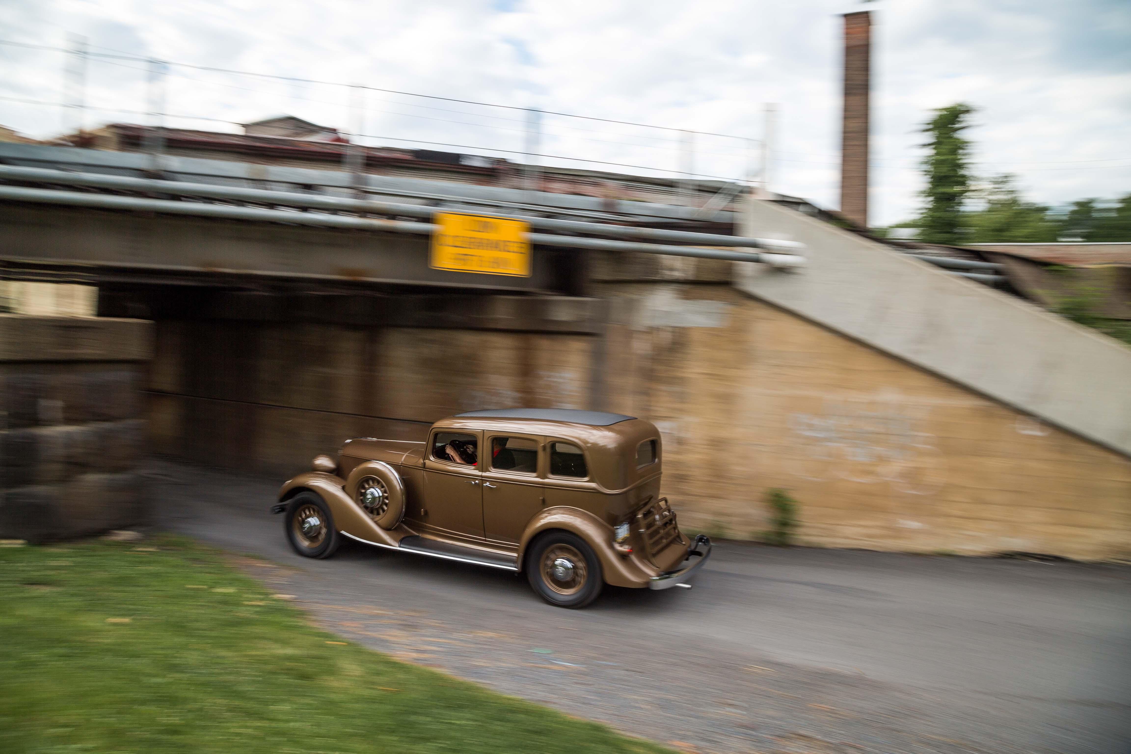 1932 Graham Blue Streak going under bridge