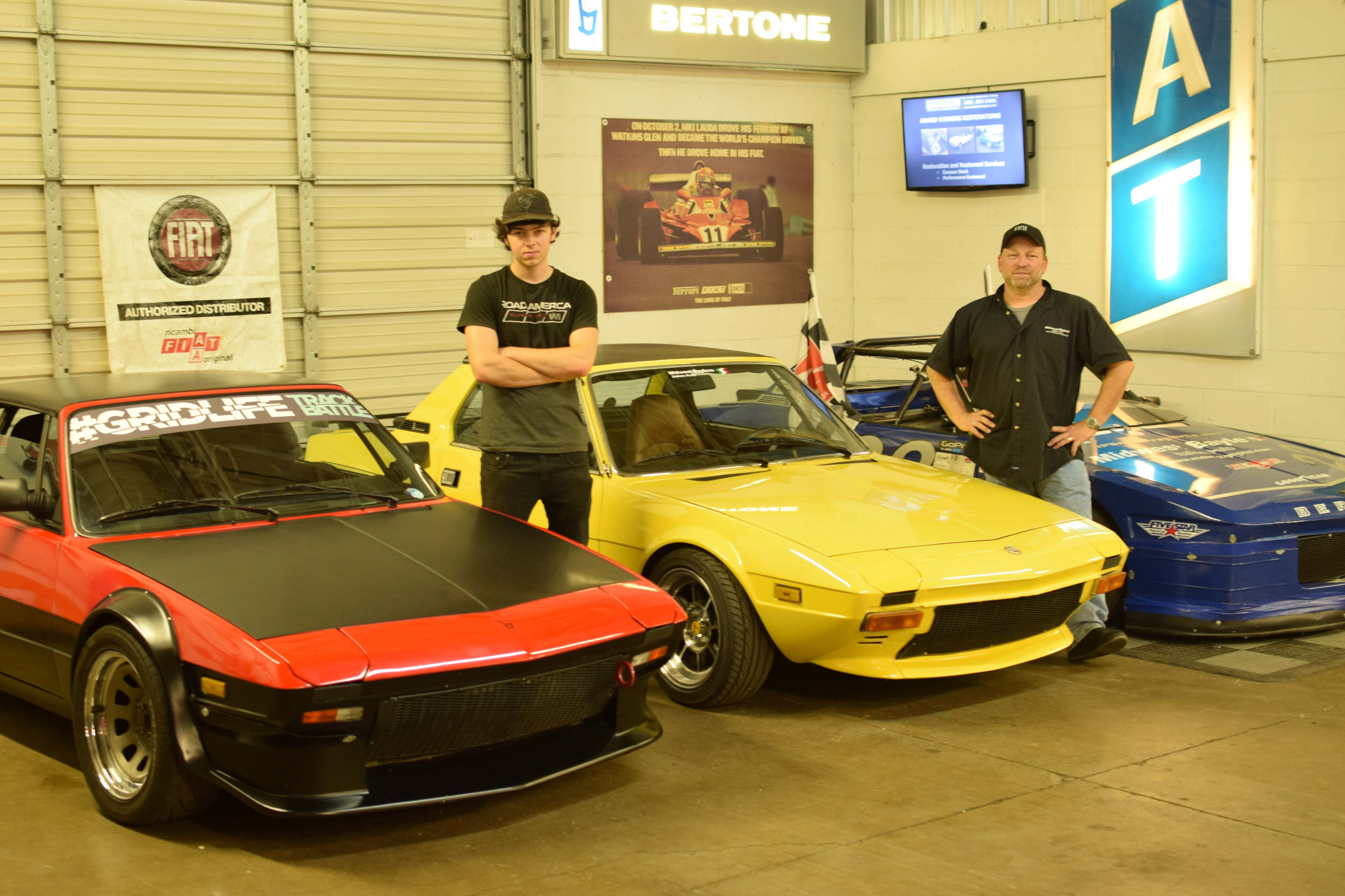Fiat x19 shop with cars and owners