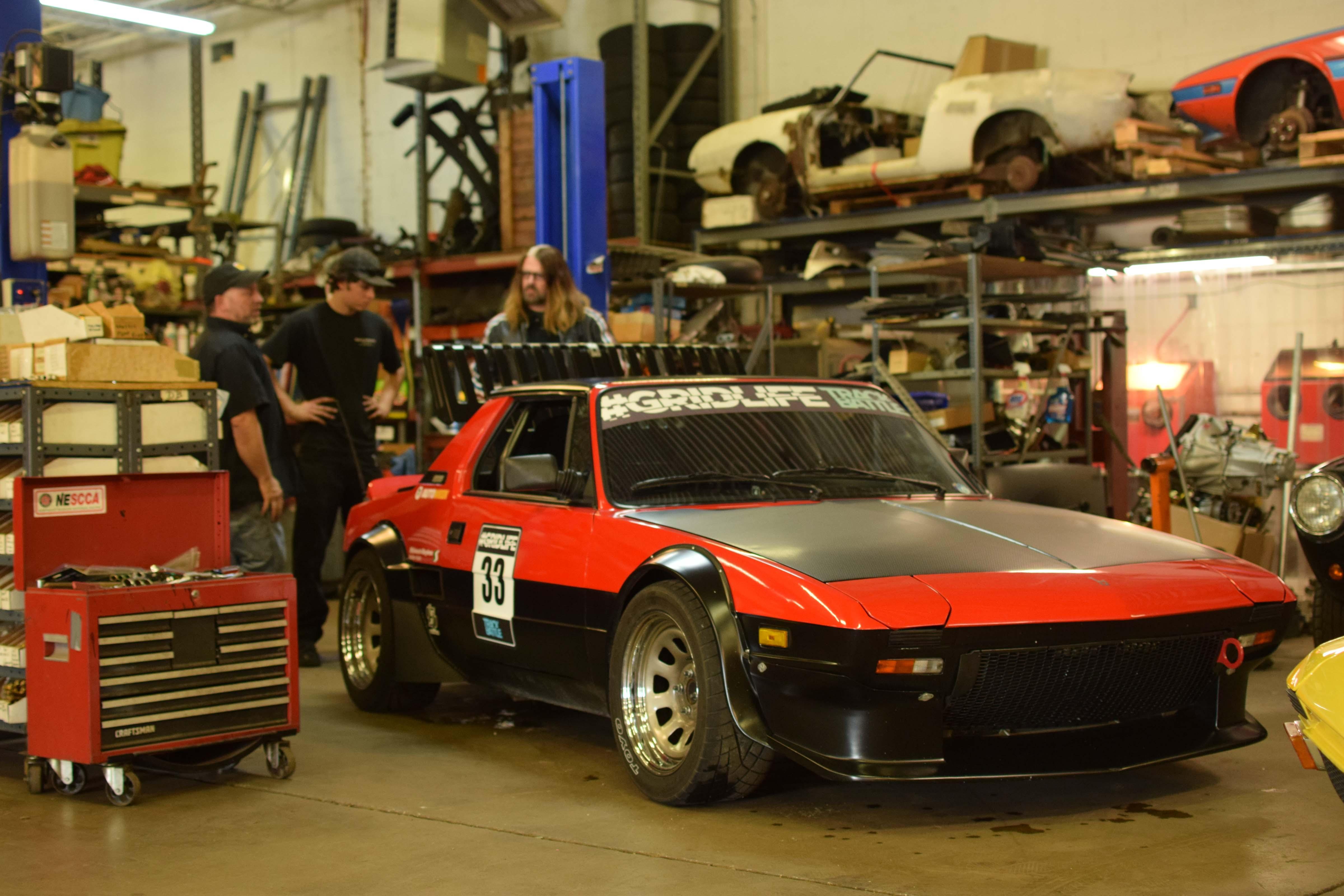 fiat x19 race car at shop