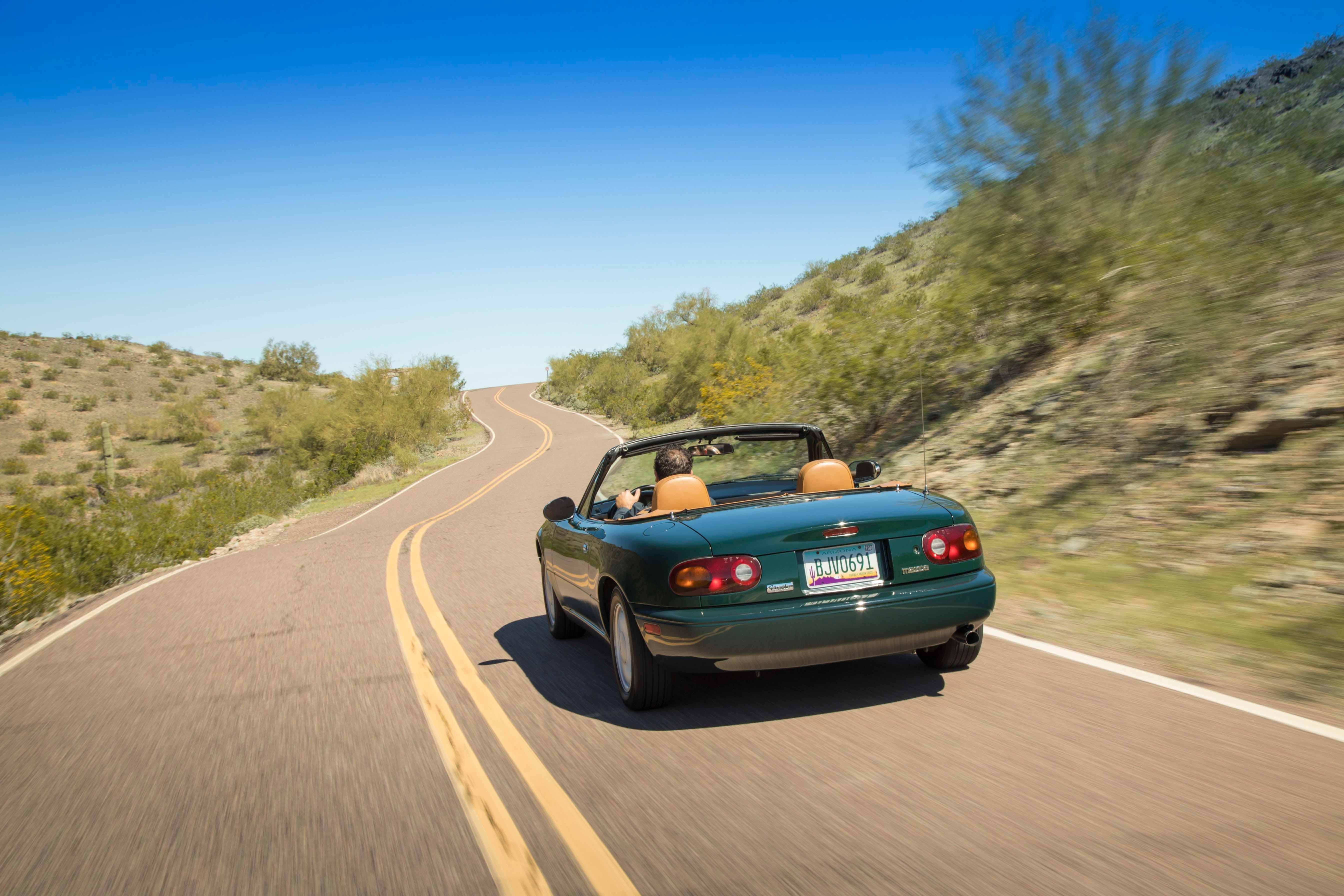 1990 Mazda MX-5 Miata green desert rear
