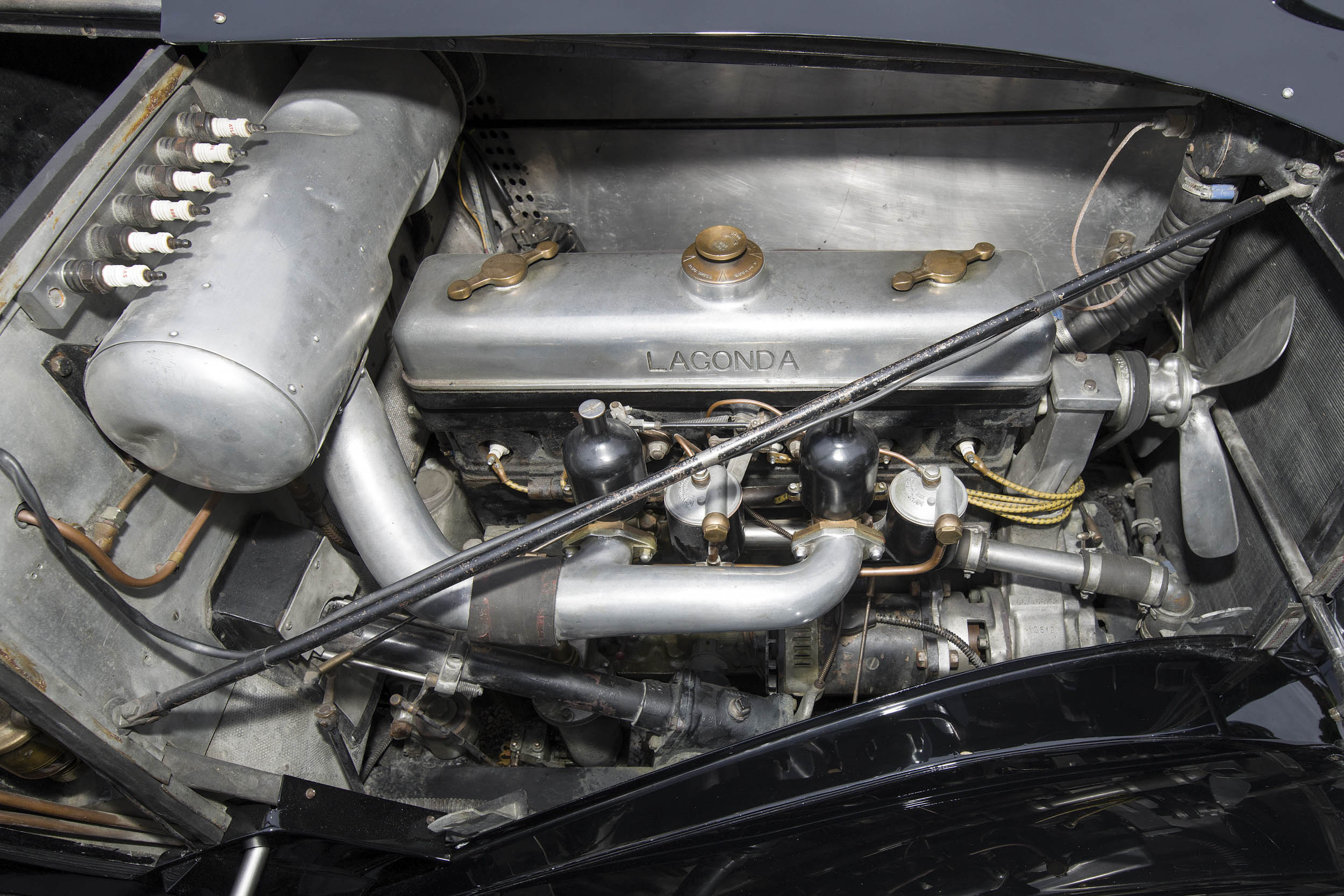 The 4.5-liter inline six-cylinder features overhead valves and two SU carburetors. It is said to produce approximately 150 horsepower, considerably more than the 5.7-liter Cadillac V-8 of the same vintage. A spare set of spark plugs is mounted above the air-cleaner housing.