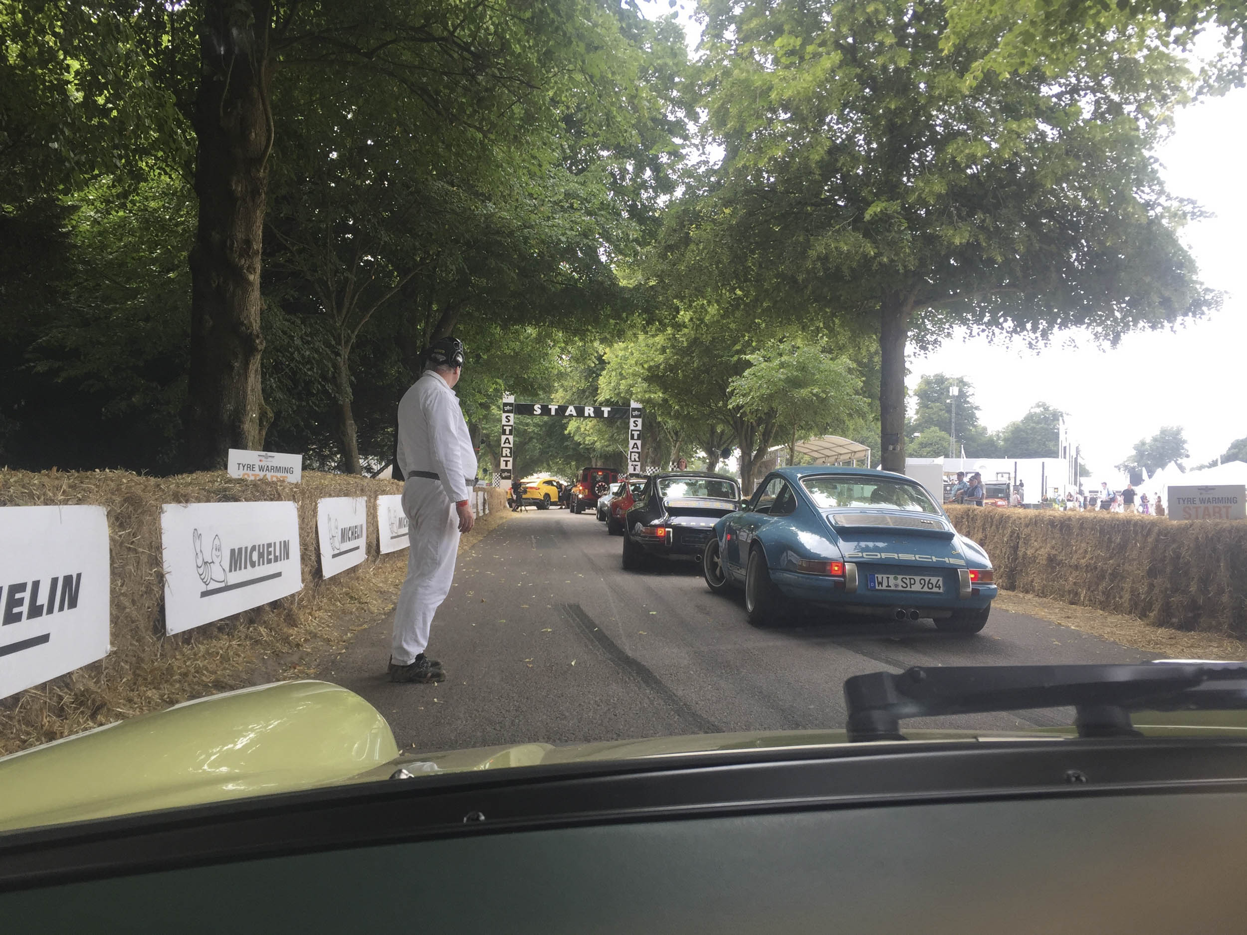 cars in line for start of goodwood hill climb